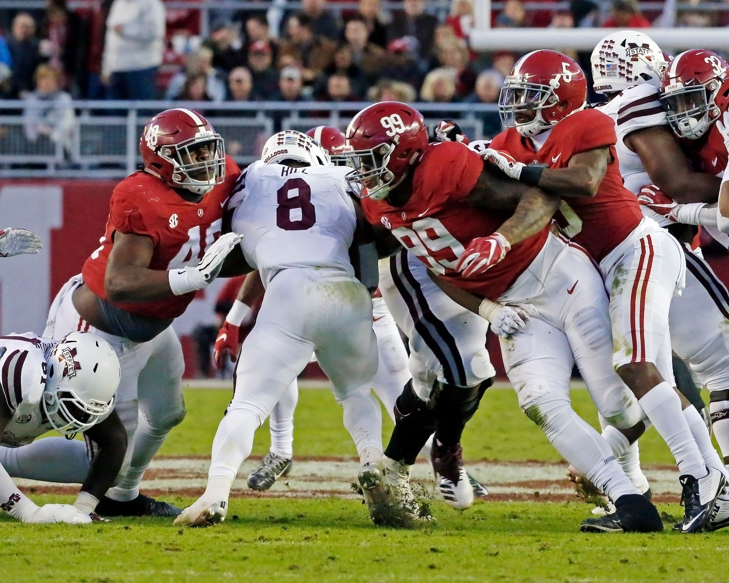 Alabama Crimson Tide defensive linemen Phidarian Mathis (48) and Raekwon Davis (99) wrap up Mississippi State Bulldogs running back Kylin Hill (8) during the second half of the game between Mississippi State and the University of Alabama at Bryant-Denny Stadium in Tuscaloosa, Al. Credit: Jason Clark / Daily Mountain Eagle