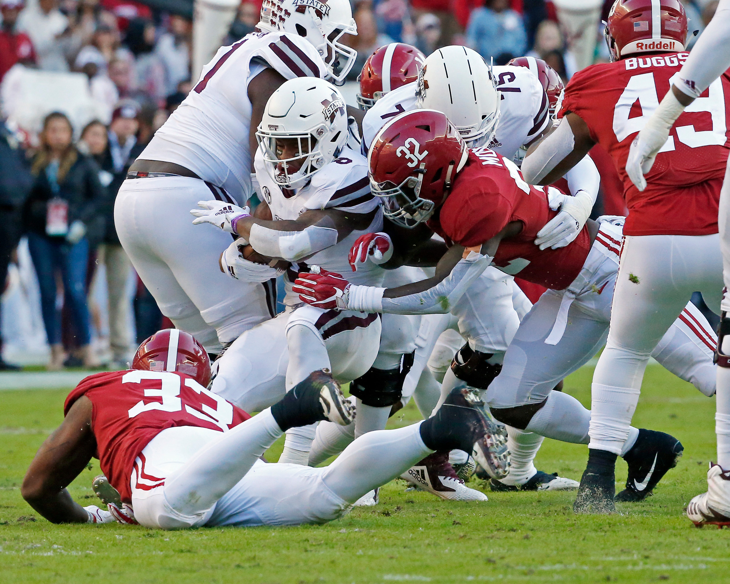 Mississippi State Bulldogs running back Kylin Hill (8) spins away from Alabama Crimson Tide linebacker Dylan Moses (32) during the game between Mississippi State and the University of Alabama at Bryant-Denny Stadium in Tuscaloosa, Al. Credit: Jason Clark / Daily Mountain Eagle