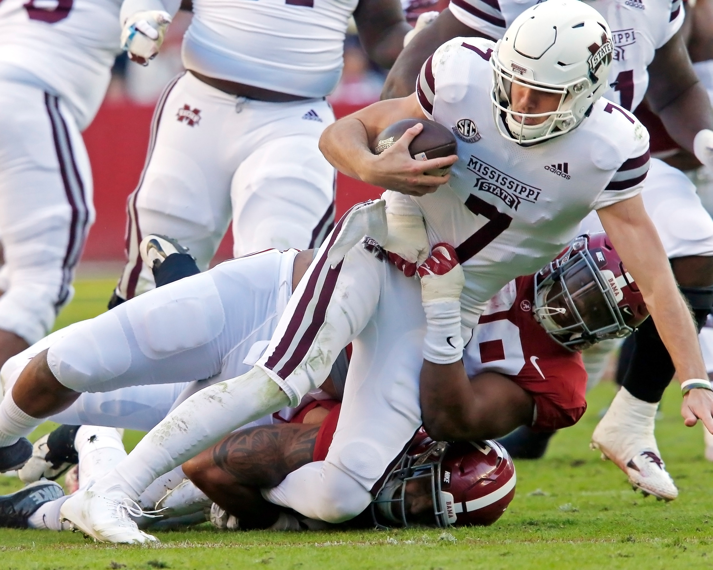 Alabama Crimson Tide defensive lineman Raekwon Davis (99) sacks Mississippi State Bulldogs quarterback Nick Fitzgerald (7) during the game between Mississippi State and the University of Alabama at Bryant-Denny Stadium in Tuscaloosa, Al. Credit: Jason Clark / Daily Mountain Eagle