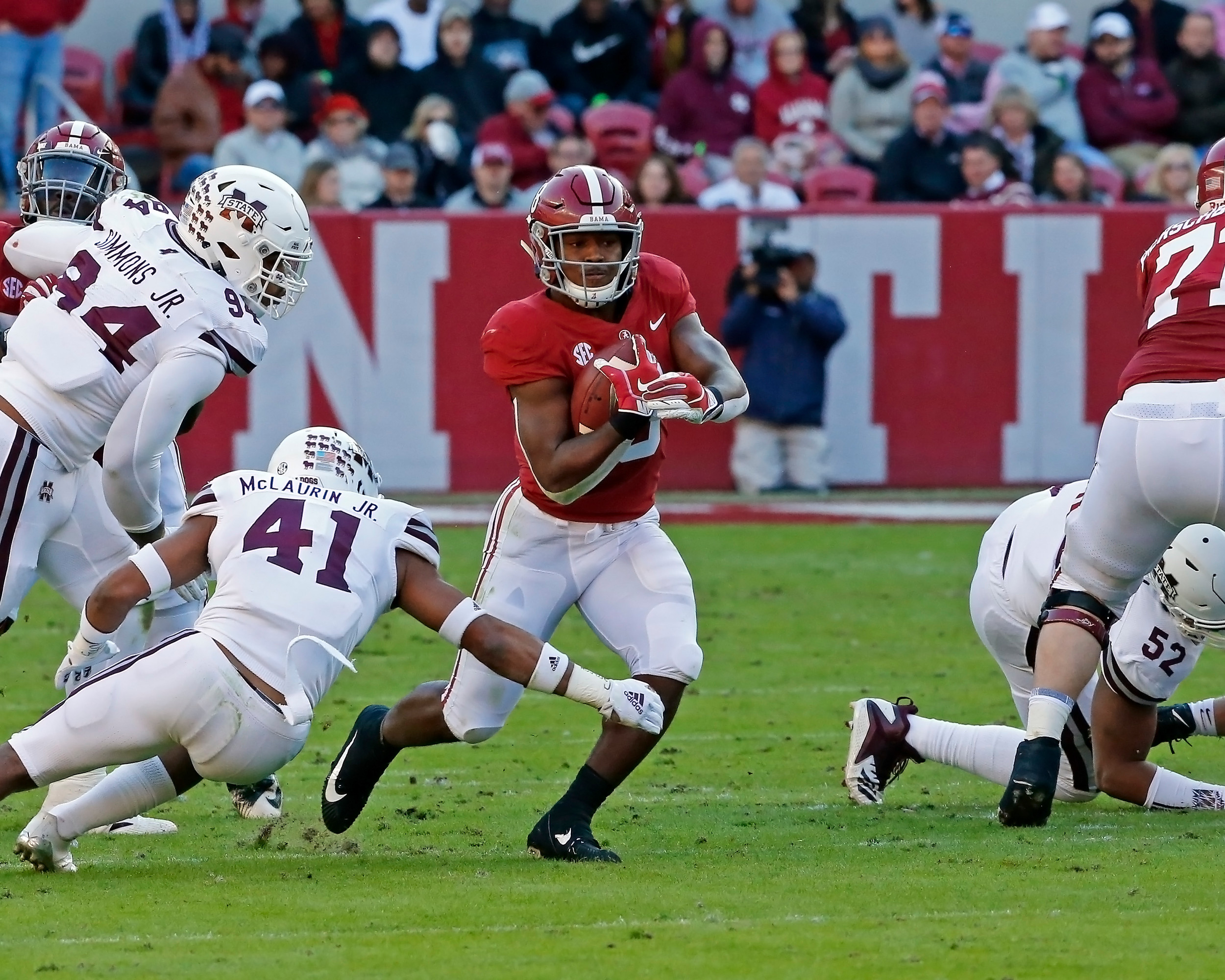 Alabama Crimson Tide running back Josh Jacobs (8) dodges a tackle from Mississippi State Bulldogs safety Mark McLaurin (41) during the game between Mississippi State and the University of Alabama at Bryant-Denny Stadium in Tuscaloosa, Al. Credit: Jason Clark / Daily Mountain Eagle