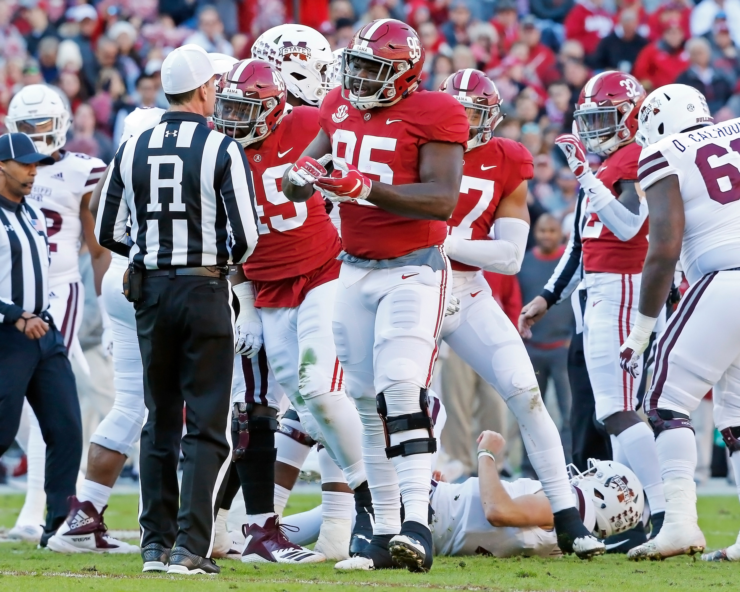 Alabama Crimson Tide defensive lineman Johnny Dwight (95) talks to an official after a play during the game between Mississippi State and the University of Alabama at Bryant-Denny Stadium in Tuscaloosa, Al. Credit: Jason Clark / Daily Mountain Eagle