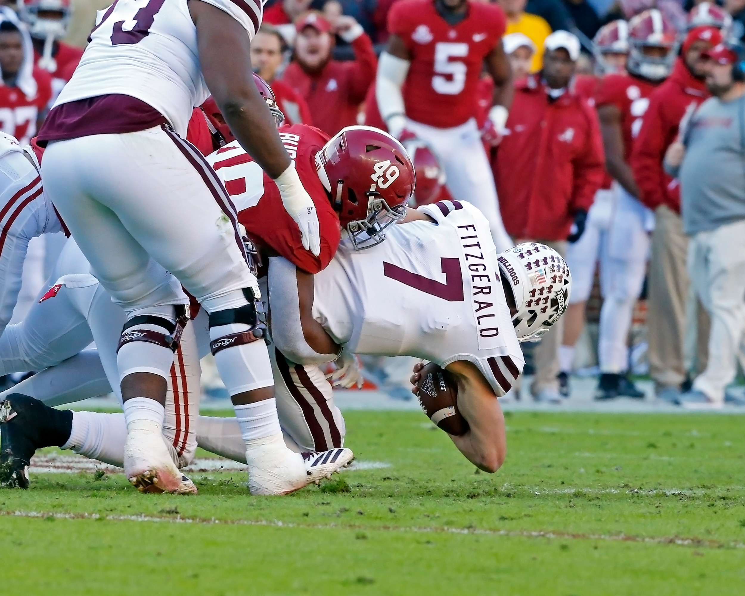 Alabama Crimson Tide defensive lineman Isaiah Buggs (49) sacks Mississippi State Bulldogs quarterback Nick Fitzgerald (7) during the game between Mississippi State and the University of Alabama at Bryant-Denny Stadium in Tuscaloosa, Al. Credit: Jason Clark / Daily Mountain Eagle