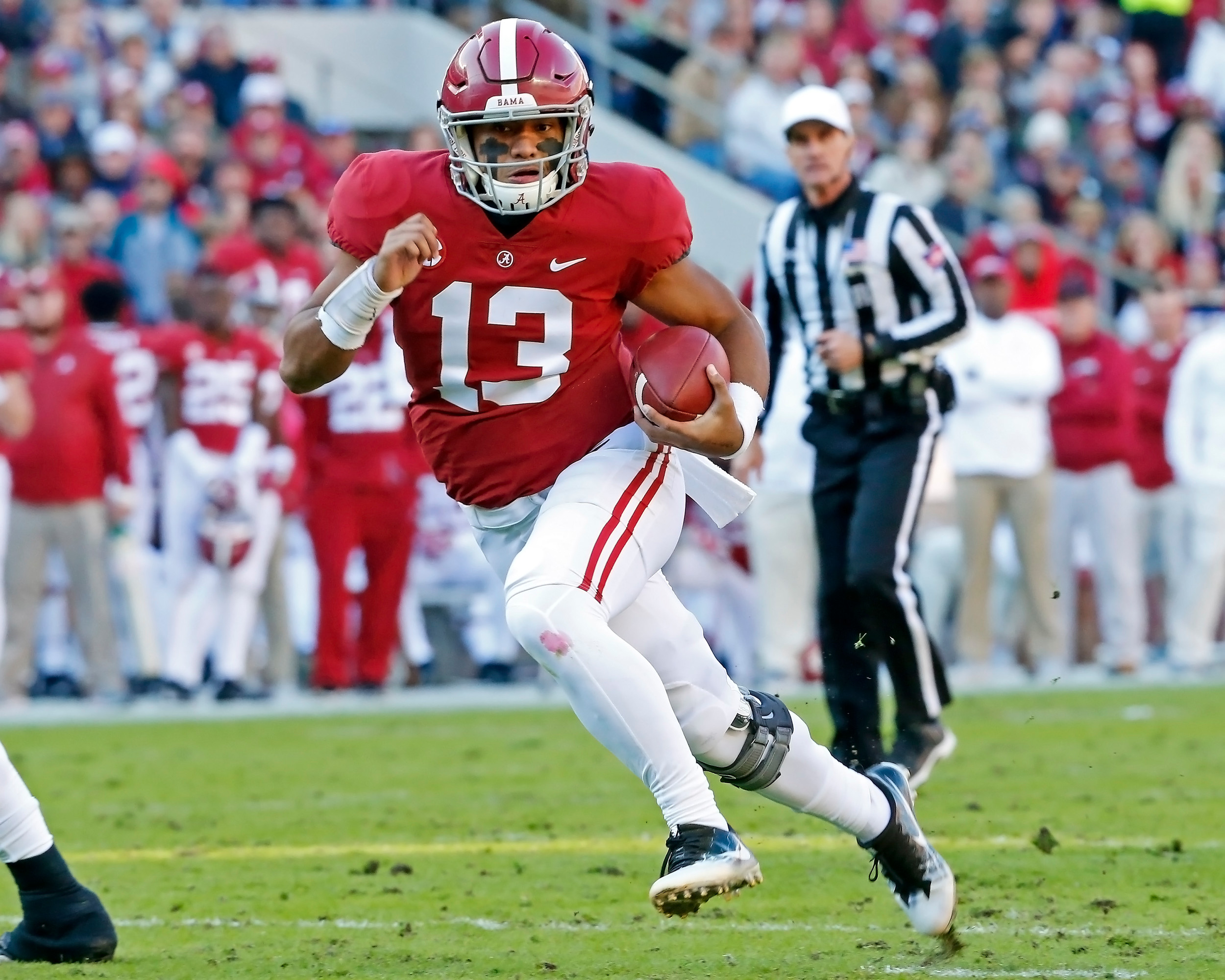 Alabama Crimson Tide quarterback Tua Tagovailoa (13) rushes from the pocket during the game between Mississippi State and the University of Alabama at Bryant-Denny Stadium in Tuscaloosa, Al. Credit: Jason Clark / Daily Mountain Eagle