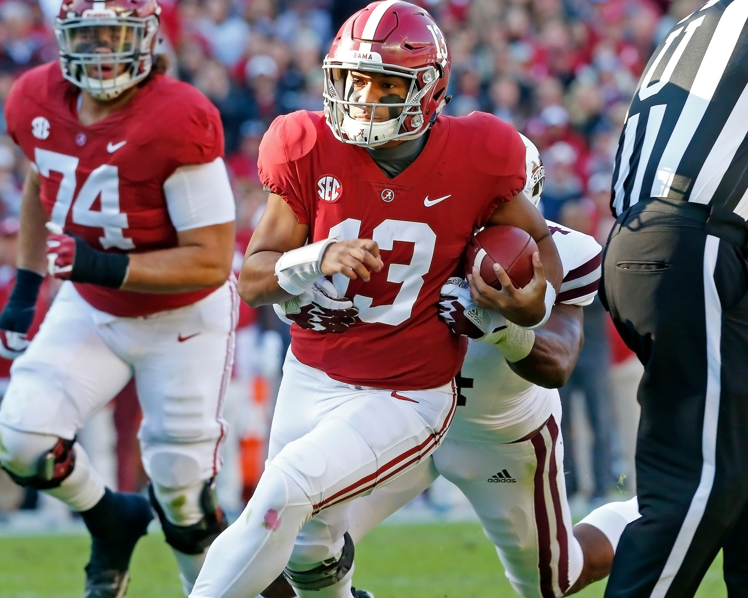 Alabama Crimson Tide quarterback Tua Tagovailoa (13) rushed for a first down during the game between Mississippi State and the University of Alabama at Bryant-Denny Stadium in Tuscaloosa, Al. Credit: Jason Clark / Daily Mountain Eagle