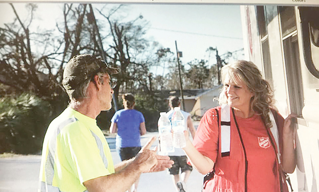 Walker County Salvation Army director Cindy Smith hands out bottles of water to a first responder while serving in Florida following Hurricane Michael.