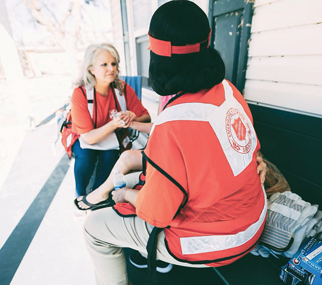 Walker County Salvation Army director Cindy Smith and another Salvation Army volunteer comfort a Hurricane Michael survivor.