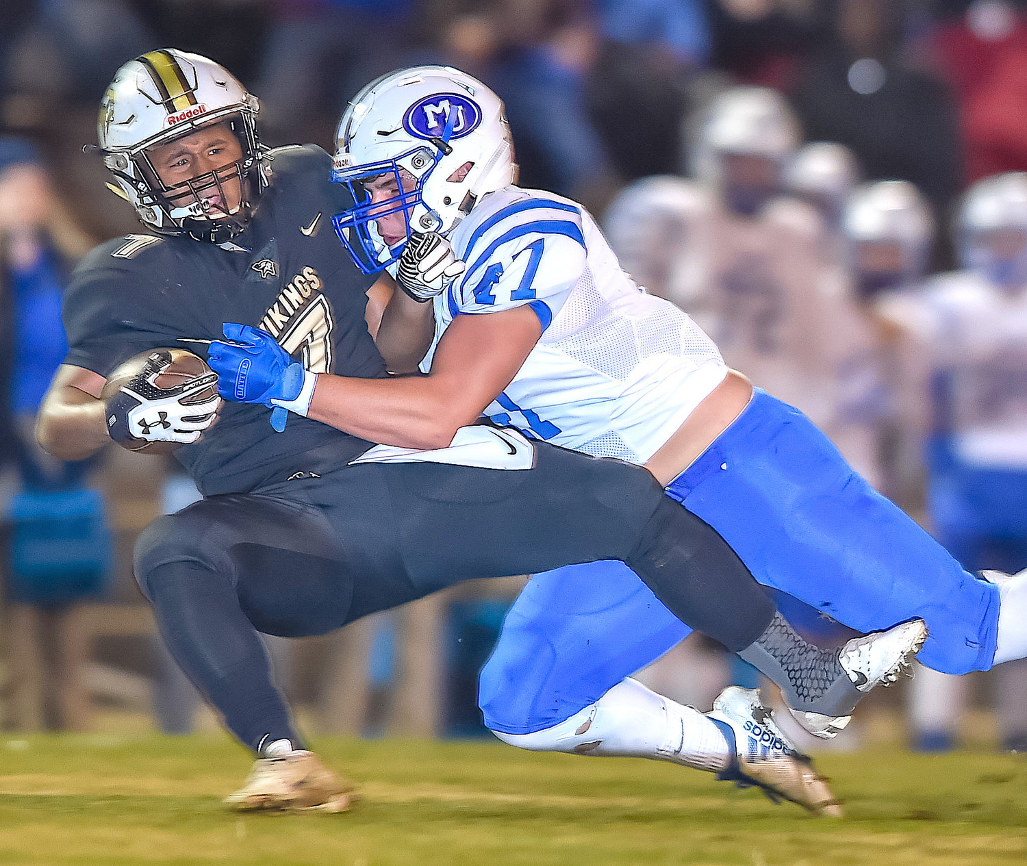 Jasper's Kaden Shelton is taken down by a Mortimer Jordan defender during Friday night's Class 5A quarterfinal game. The Blue Devils eliminated the Vikings from the playoffs in a 41-21 win.