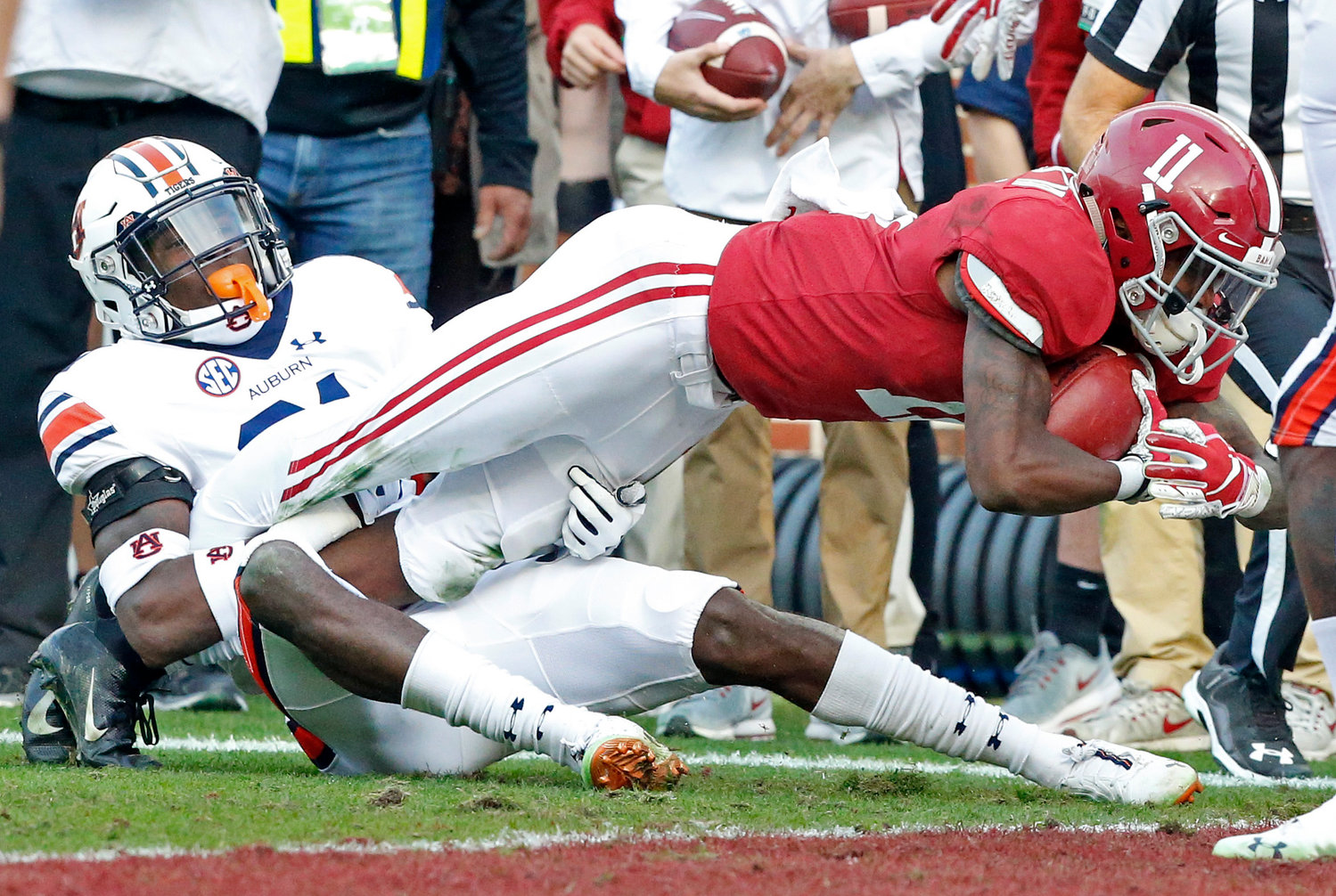 Alabama's Henry Ruggs III stretches for a touchdown during the Tide's 52-21 win over Auburn in Saturday's Iron Bowl at Bryant-Denny Stadium. Alabama improved to 12-0 on the season heading into next week's SEC Championship Game.