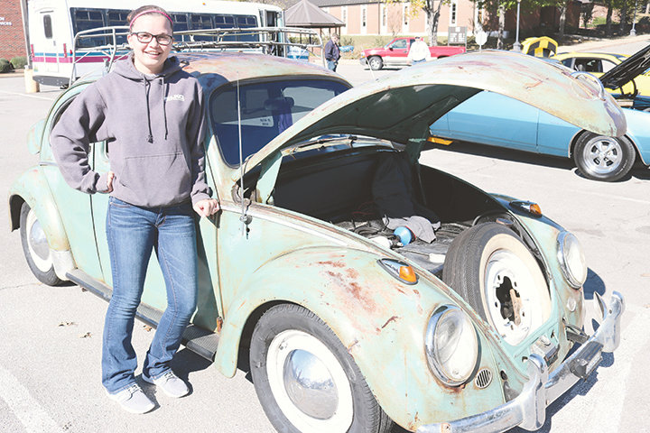 Kassey Rogers of Sumiton stands by her modified 1963 VW Beetle at a recent car show in Sumiton.