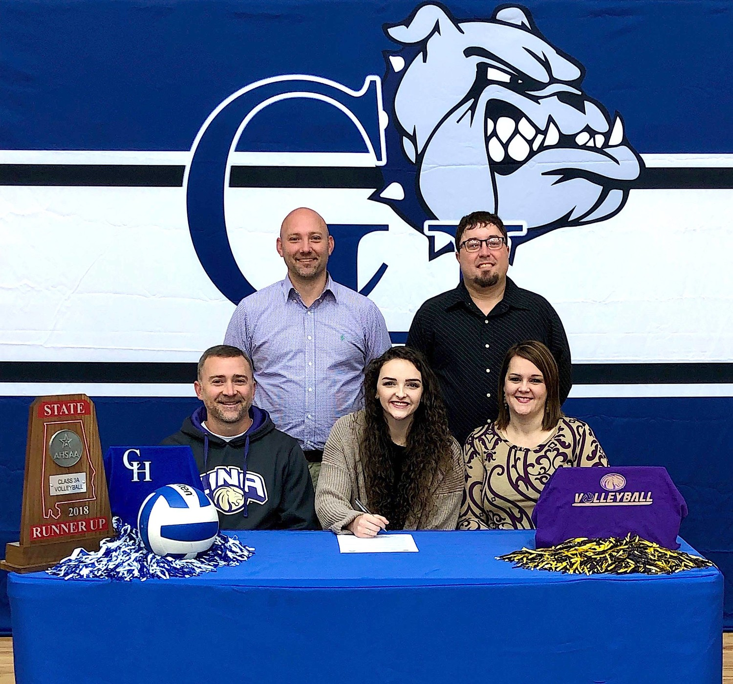Carbon Hill volleyball player Alyssa Dutton, center, signed a letter of intent with the University of North Alabama earlier this month. She will play for the Lions starting next fall. Present at the signing were, seated from left, Matt Dutton, Alyssa Dutton and Wendy Dutton, back row, Carbon Hill head coach Saige Beaty and assistant coach Brandon Phillips.
