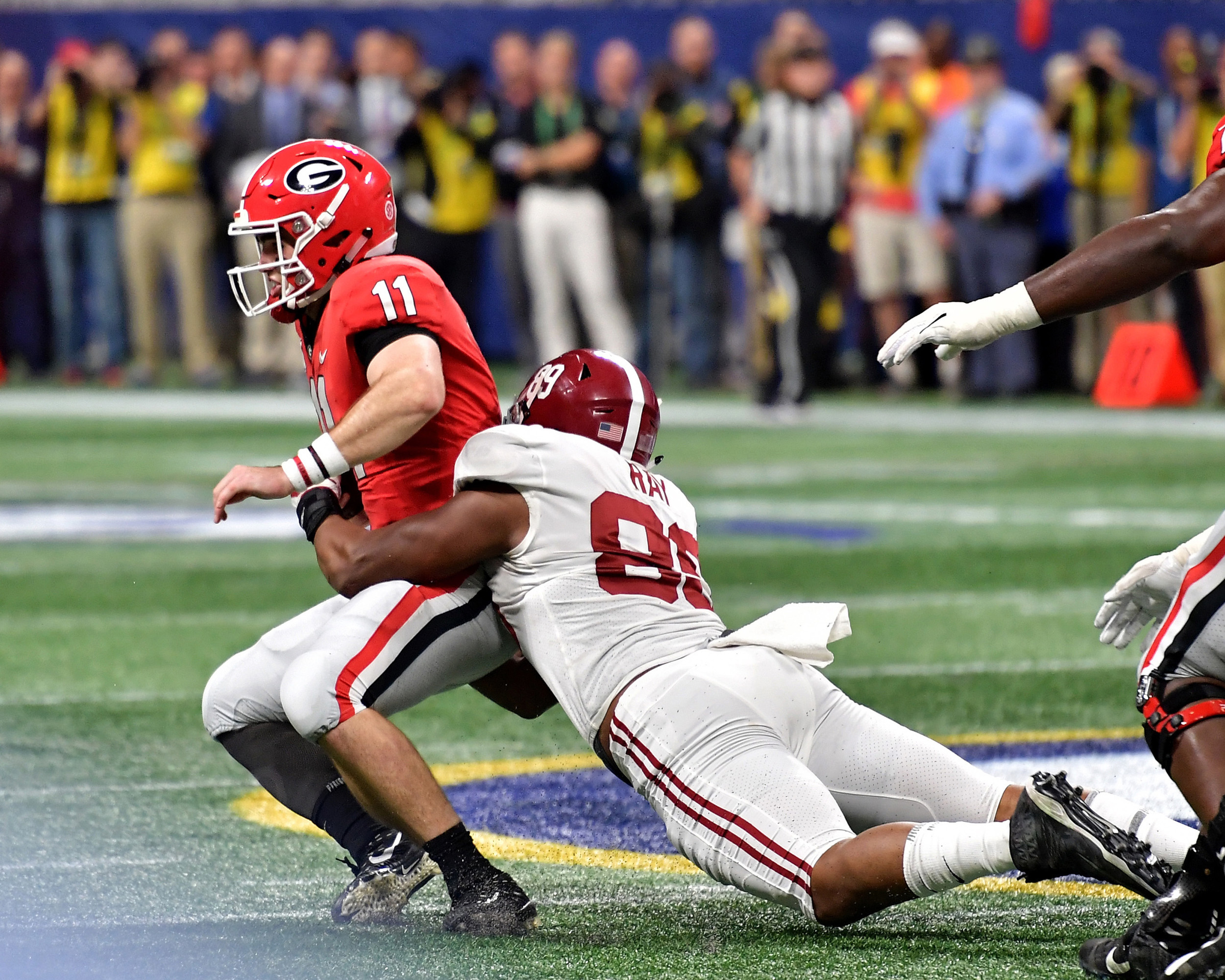 Georgia Bulldogs quarterback Jake Fromm (11) is sacked for the last time during the 2018 SEC Championship football game against the Alabama Crimson Tide at Mercedes-Benz Stadium in Atlanta, Ga., on Dec. 1, 2018. Alabama wins 35-28. (Photo by Lee Walls)