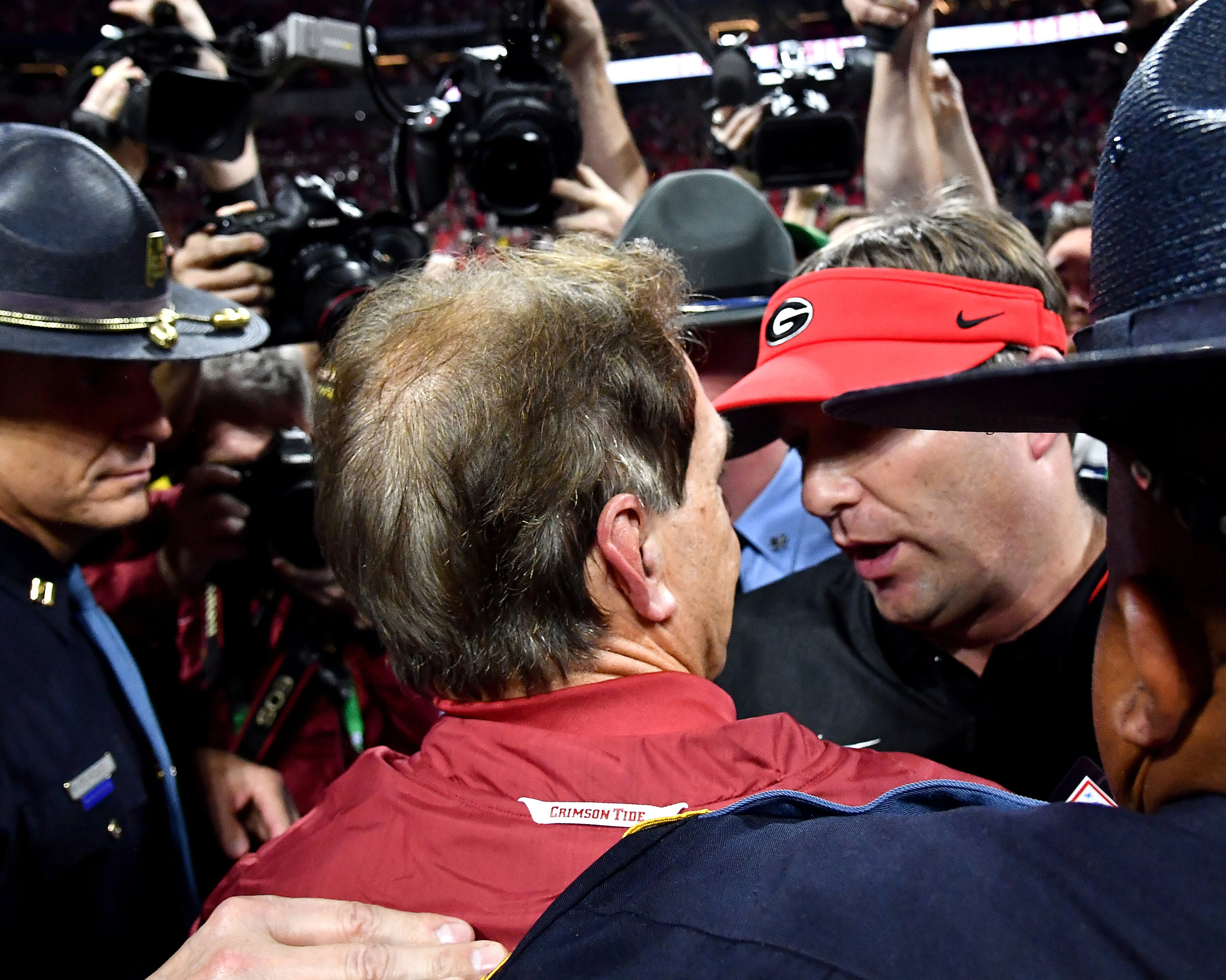 Alabama Crimson Tide head coach Nick Saban meets Georgia Bulldogs head coach Kirby Smart at the center of the field following Alabama's defeat of Georgia in the 2018 SEC Championship football game at Mercedes-Benz Stadium in Atlanta, Ga., on Dec. 1, 2018. Alabama wins 35-28. (Photo by Lee Walls)