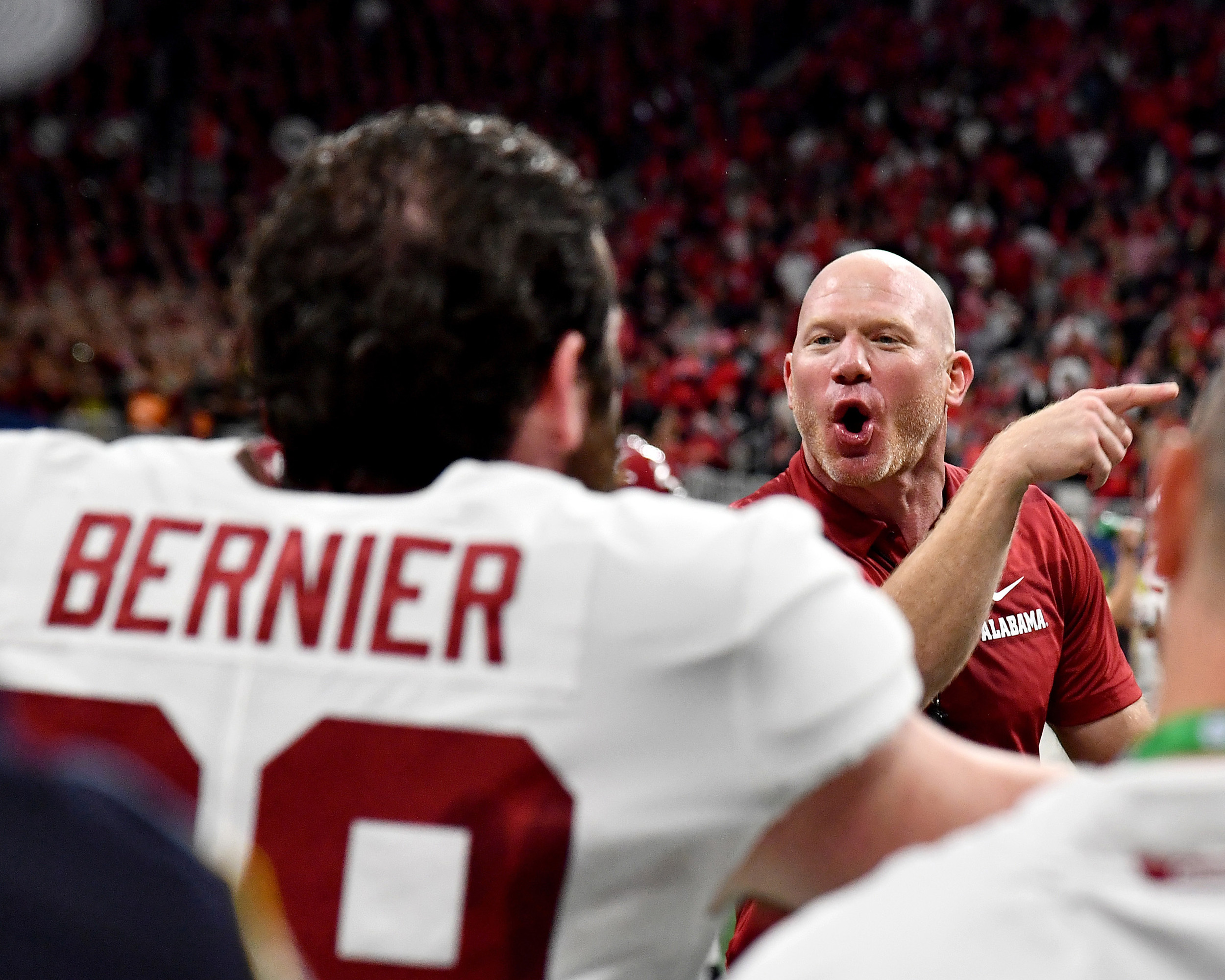 Alabama strength coach Scott Cochran fires up his players late in the fourth quarter of the 2018 SEC Championship football game against the Georgia Bulldogs at Mercedes-Benz Stadium in Atlanta, Ga., on Dec. 1, 2018. Alabama wins 35-28. (Photo by Lee Walls)