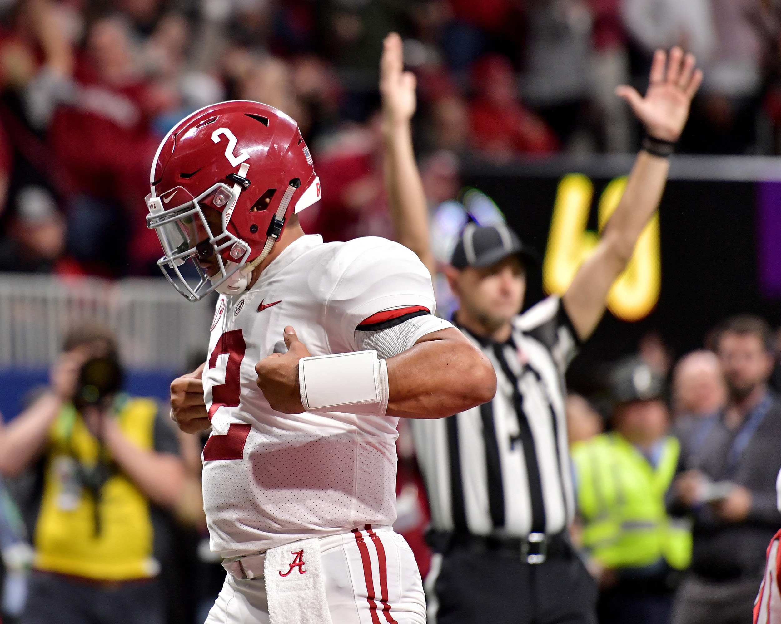 Alabama Crimson Tide quarterback Jalen Hurts (2) celebrates his game-winning touchdown late in the fourth quarter of the 2018 SEC Championship football game against the Georgia Bulldogs at Mercedes-Benz Stadium in Atlanta, Ga., on Dec. 1, 2018. Alabama wins 35-28. (Photo by Lee Walls)