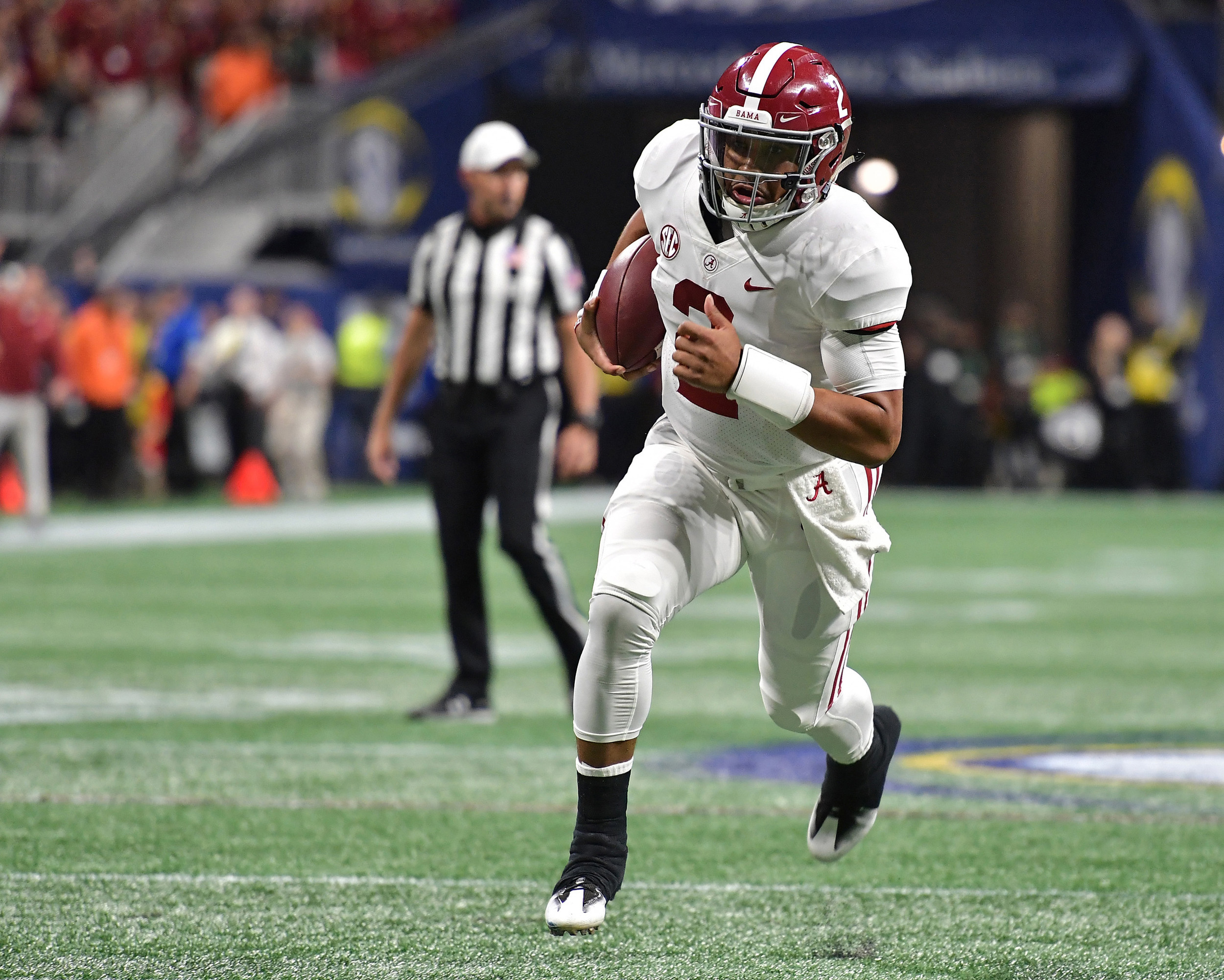 Alabama Crimson Tide quarterback Jalen Hurts (2) with a quarterback keeper, and on his way to the game-winning touchdown late in the fourth quarter of the 2018 SEC Championship football game against the Georgia Bulldogs at Mercedes-Benz Stadium in Atlanta, Ga., on Dec. 1, 2018. Alabama wins 35-28. (Photo by Lee Walls)