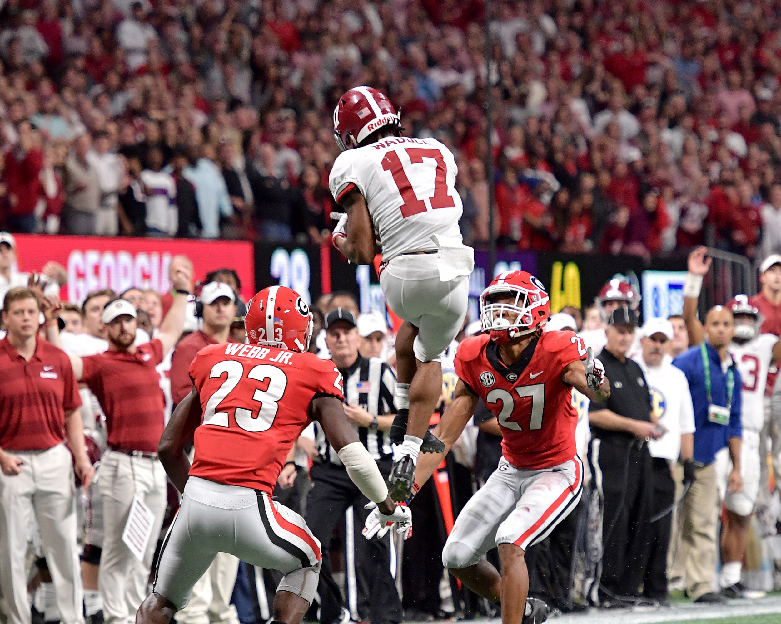 Alabama Crimson Tide wide receiver Jaylen Waddle (17) goes vertical to make an incredible catch in the fourth quarter of the 2018 SEC Championship football game against the Georgia Bulldogs at Mercedes-Benz Stadium in Atlanta, Ga., on Dec. 1, 2018. Alabama wins 35-28. (Photo by Lee Walls)