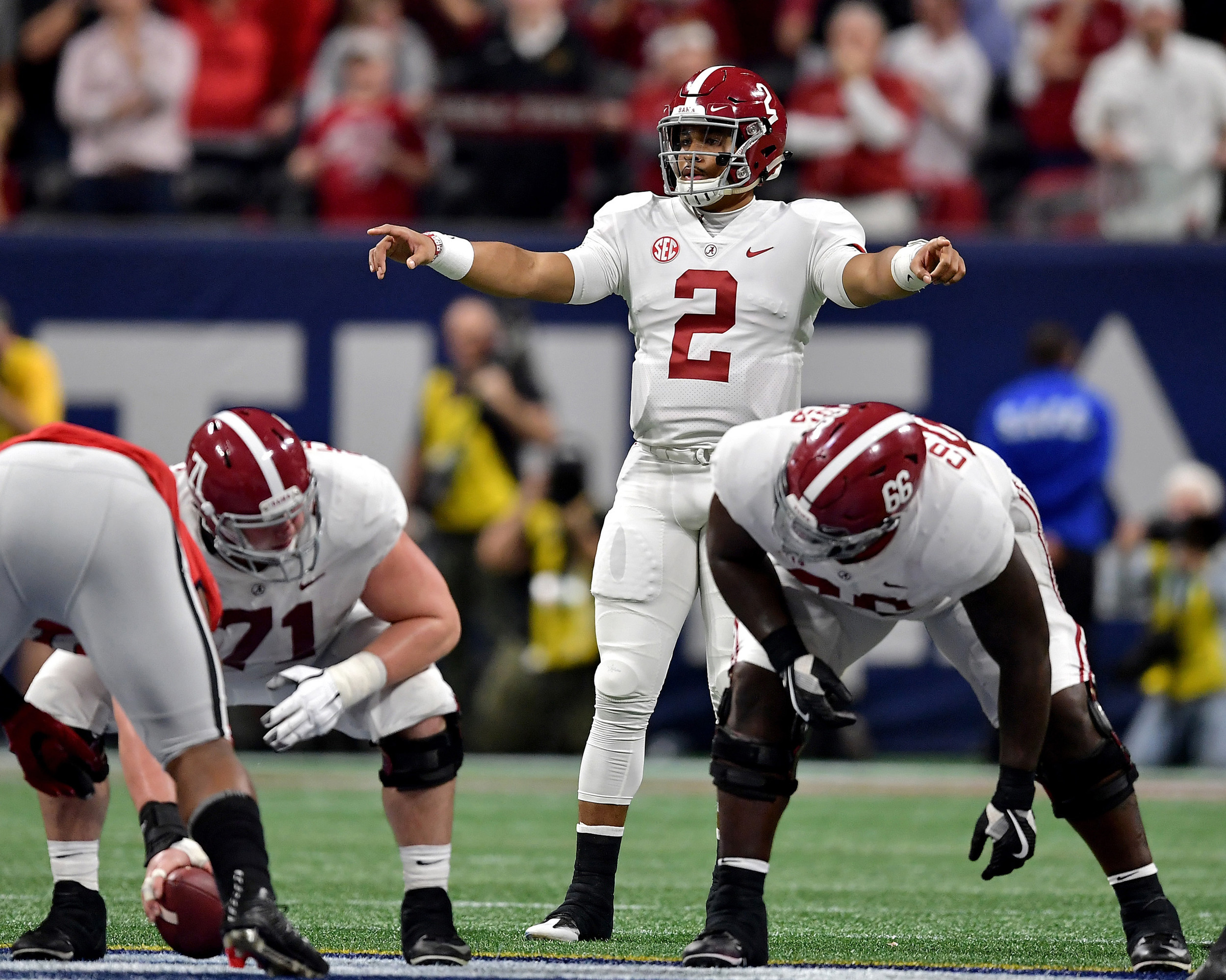 Alabama Crimson Tide quarterback Jalen Hurts (2) commands his offensive line late in the fourth quarter of the  2018 SEC Championship football game against the Georgia Bulldogs at Mercedes-Benz Stadium in Atlanta, Ga., on Dec. 1, 2018. Alabama wins 35-28. (Photo by Lee Walls)