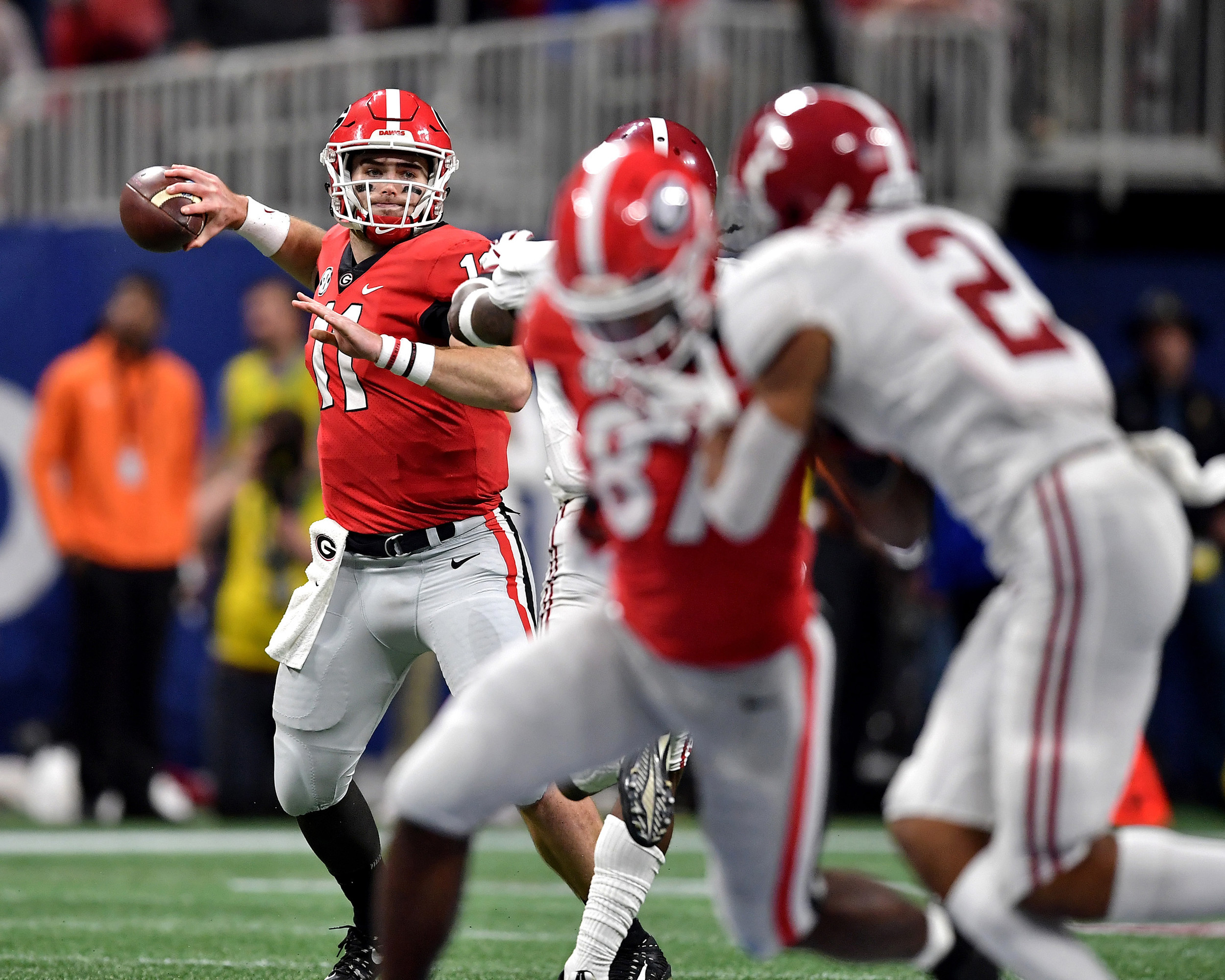 Georgia Bulldogs quarterback Jake Fromm (11) looks for a receiver during the second half of the 2018 SEC Championship football game against the Alabama Crimson Tide at Mercedes-Benz Stadium in Atlanta, Ga., on Dec. 1, 2018. Alabama wins 35-28. (Photo by Lee Walls)