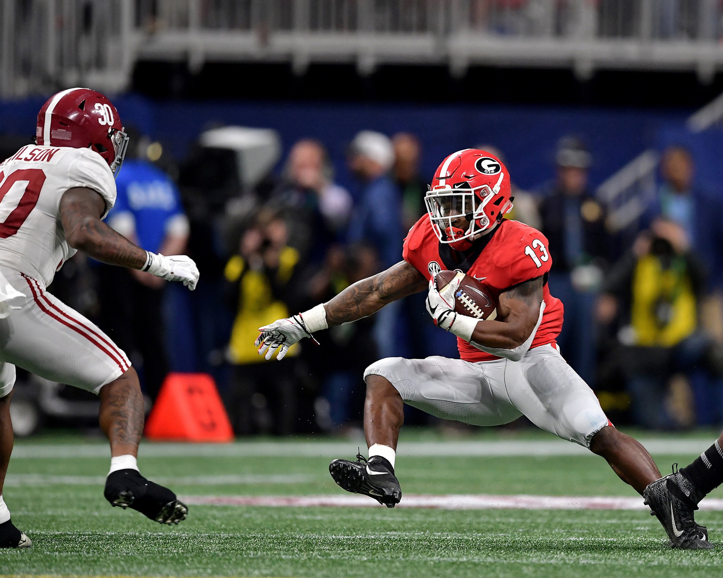 Georgia Bulldogs running back Elijah Holyfield (13) with a carry during the second half of the 2018 SEC Championship football game against the Alabama Crimson Tide at Mercedes-Benz Stadium in Atlanta, Ga., on Dec. 1, 2018. Alabama wins 35-28. (Photo by Lee Walls)