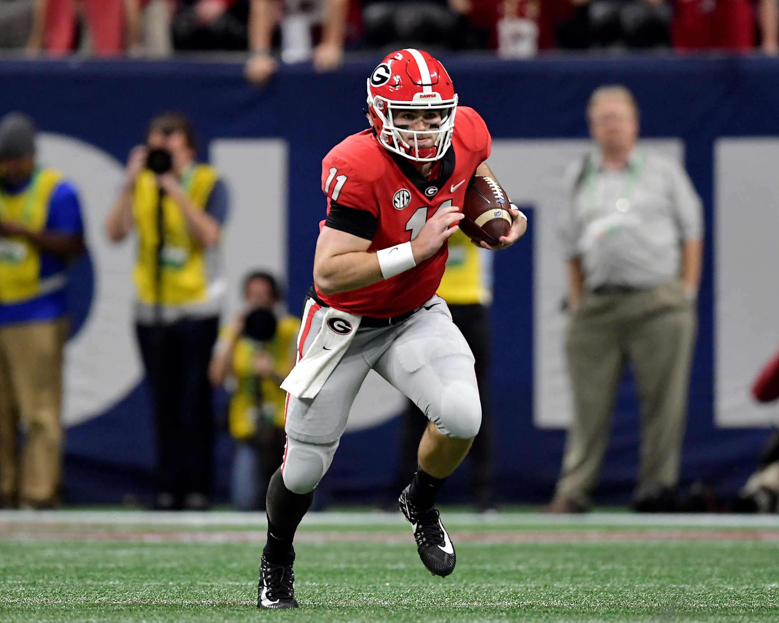 Georgia Bulldogs quarterback Jake Fromm (11) with a keeper during the second half of the 2018 SEC Championship football game against the Alabama Crimson Tide, at Mercedes-Benz Stadium in Atlanta, Ga., on Dec. 1, 2018. Alabama wins 35-28. (Photo by Lee Walls)