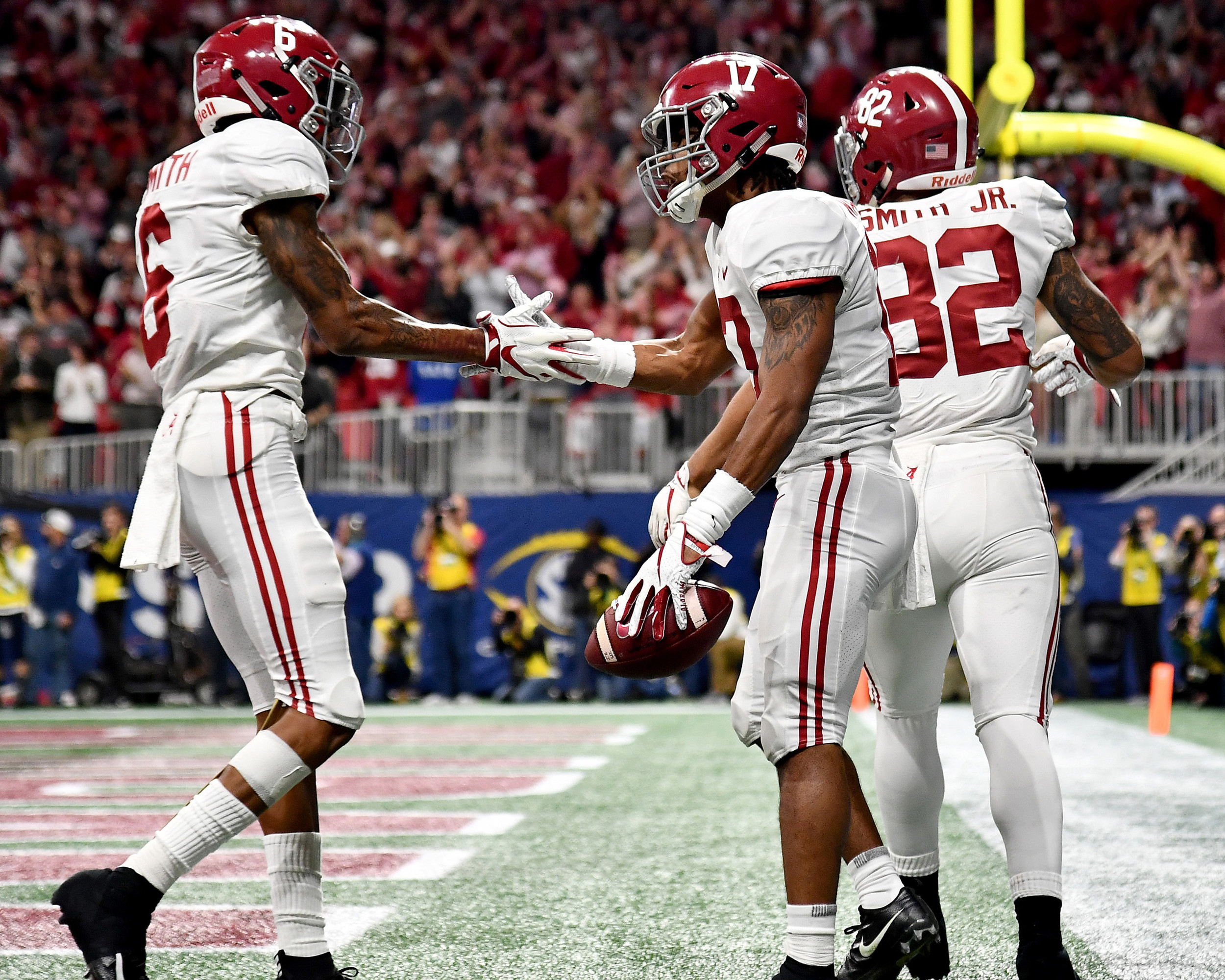 Alabama Crimson Tide wide receiver Jaylen Waddle (17) celebrates a touchdown during the second half of the 2018 SEC Championship football game against the Georgia Bulldogs at Mercedes-Benz Stadium in Atlanta, Ga., on Dec. 1, 2018. Alabama wins 35-28. (Photo by Lee Walls)