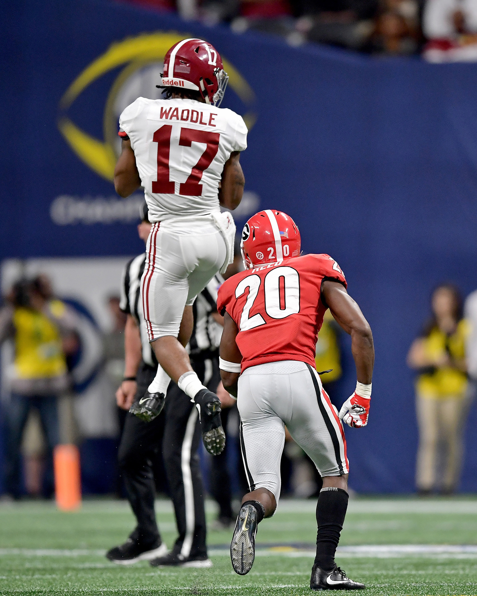 Alabama Crimson Tide wide receiver Jaylen Waddle (17) leaps to make the catch during the second half of the 2018 SEC Championship football game against the Georgia Bulldogs at Mercedes-Benz Stadium in Atlanta, Ga., on Dec. 1, 2018. Alabama wins 35-28. (Photo by Lee Walls)