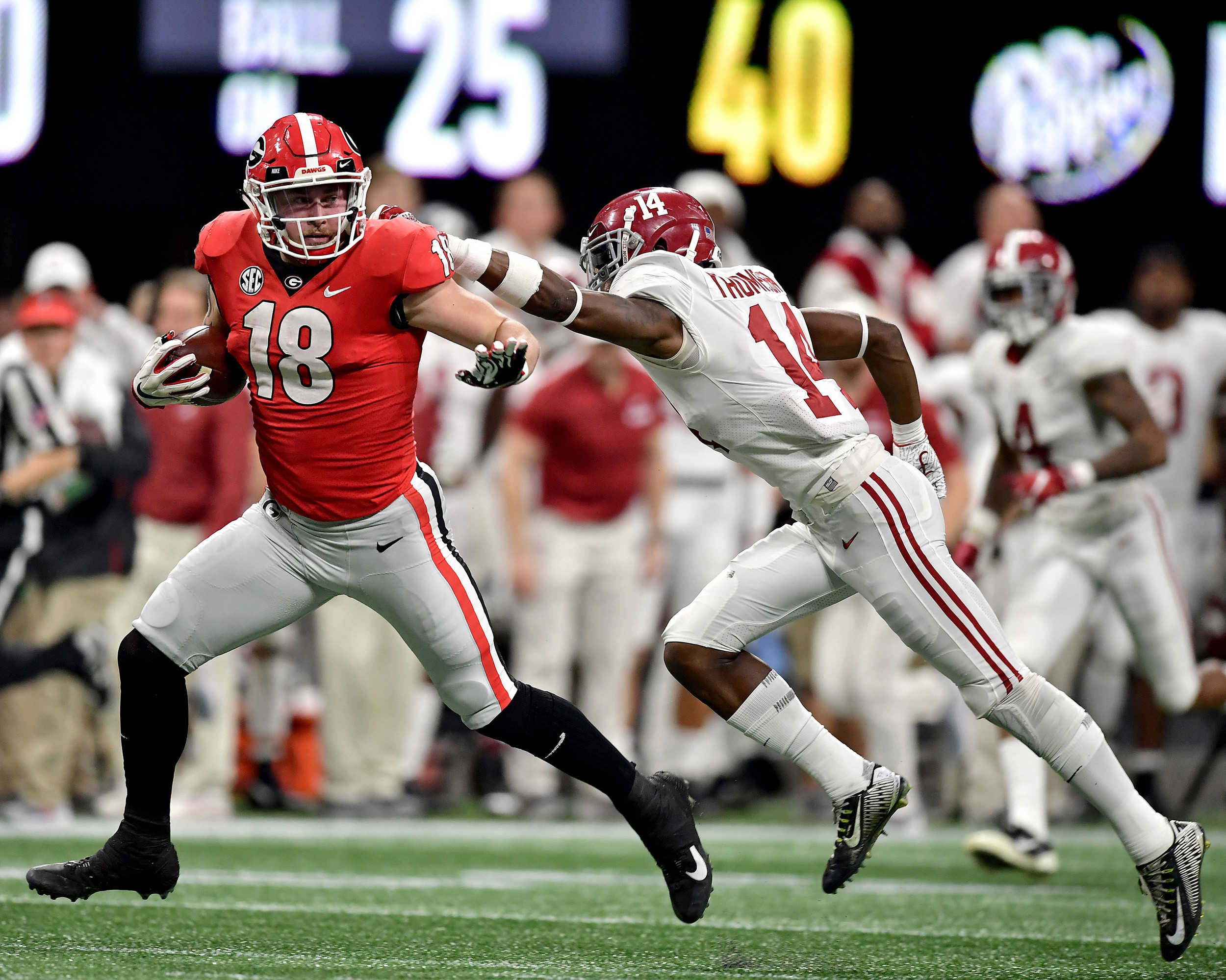 Georgia Bulldogs tight end Isaac Nauta (18) with a big catch and extra yards during the second half of the 2018 SEC Championship football game at Mercedes-Benz Stadium in Atlanta, Ga., on Dec. 1, 2018. Alabama wins 35-28. (Photo by Lee Walls)