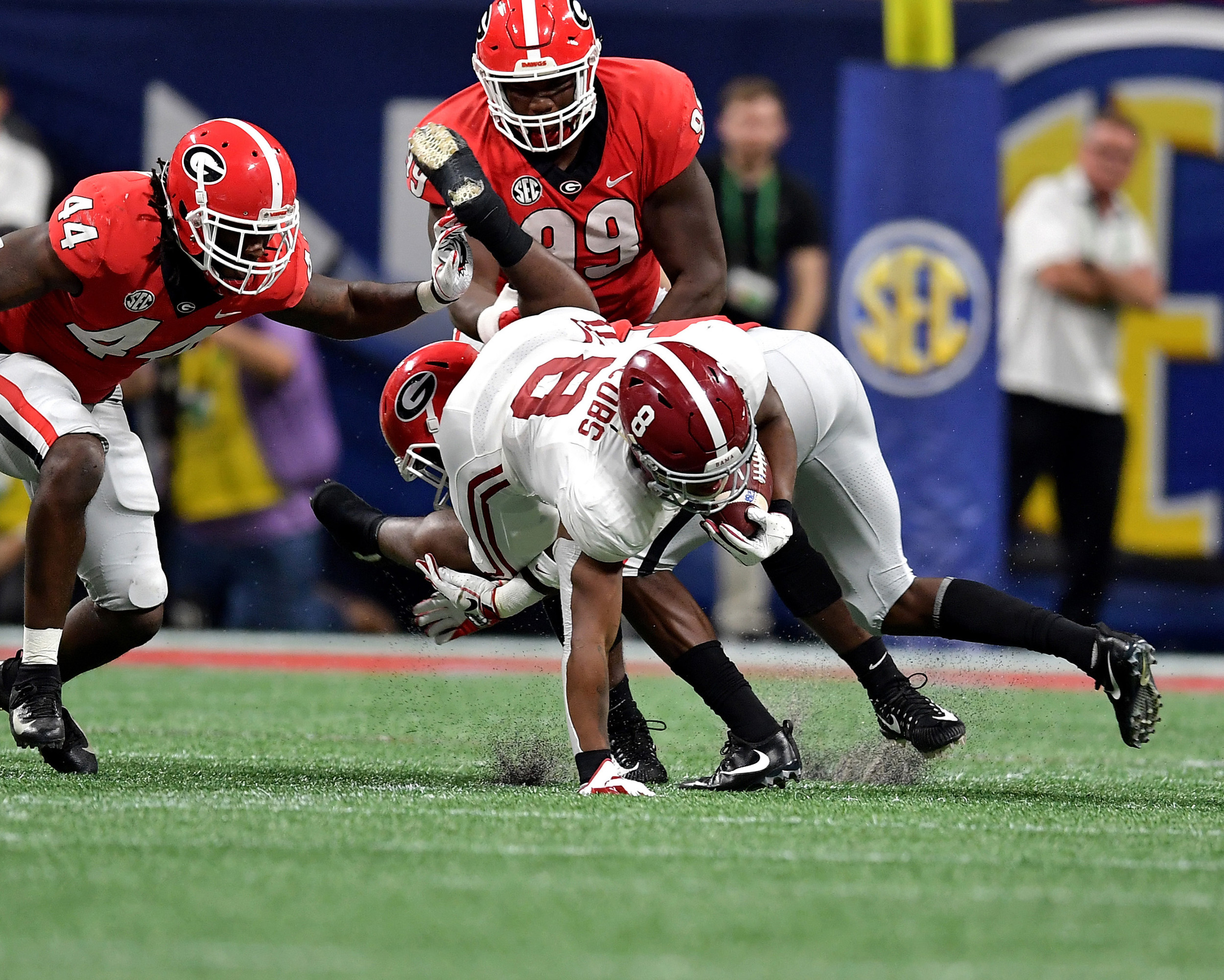 Alabama Crimson Tide running back Josh Jacobs (8) putting in the extra effort to get another yard during the second half of the 2018 SEC Championship football game against the Georgia Bulldogs at Mercedes-Benz Stadium in Atlanta, Ga., on Dec. 1, 2018. Alabama wins 35-28. (Photo by Lee Walls)