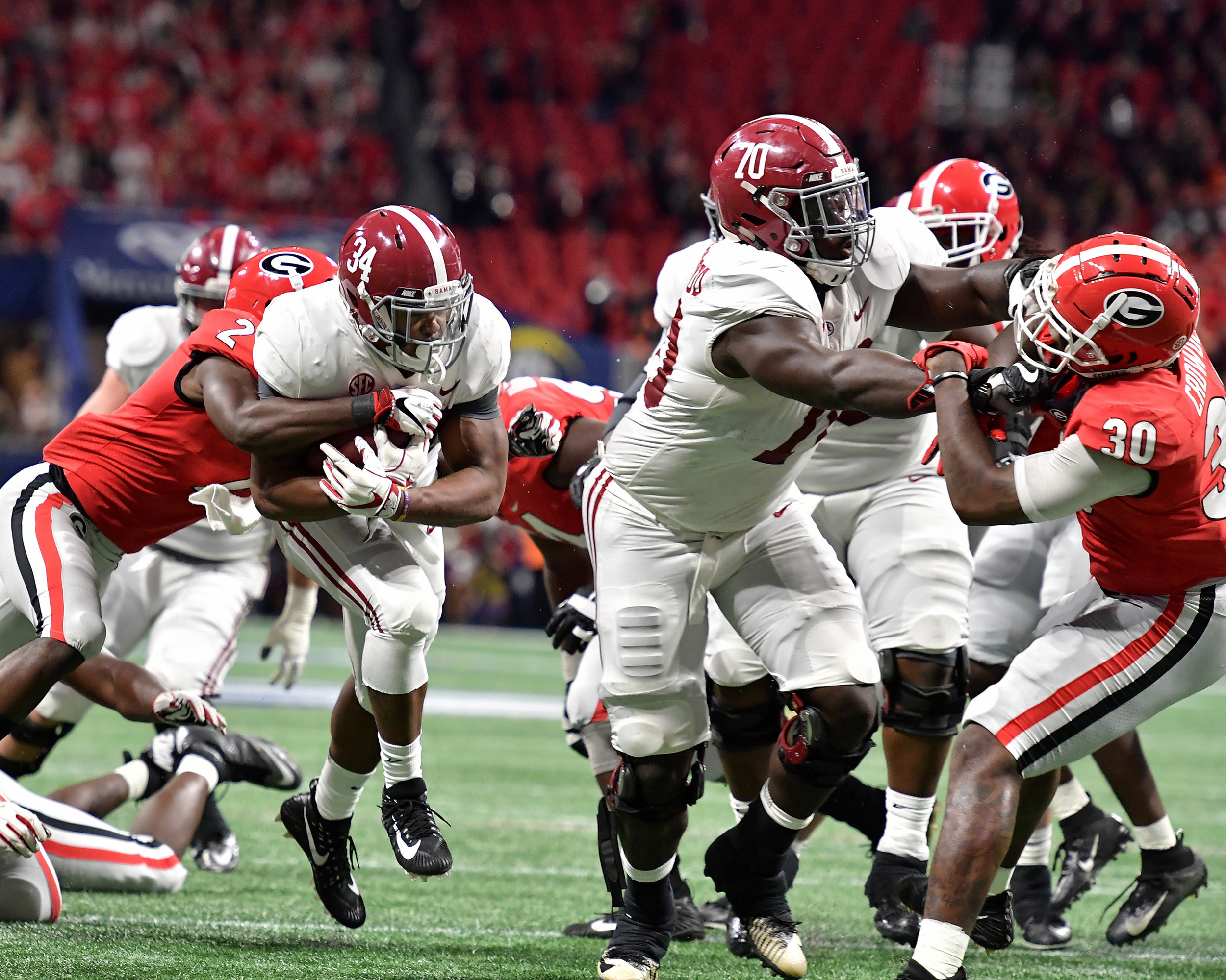 Alabama Crimson Tide running back Damien Harris (34) with a carry during the first half of the 2018 SEC Championship football game against the Georgia Bulldogs at Mercedes-Benz Stadium in Atlanta, Ga., on Dec. 1, 2018. Alabama wins 35-28. (Photo by Lee Walls)