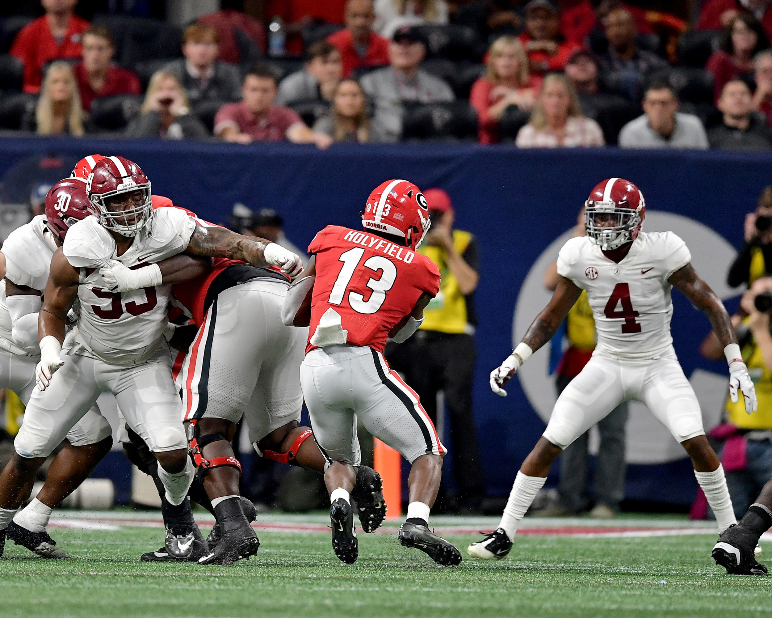 Georgia Bulldogs running back Elijah Holyfield (13) with a carry up the middle during the first half of the 2018 SEC Championship football game at Mercedes-Benz Stadium in Atlanta, Ga., on Dec. 1, 2018. Alabama wins 35-28. (Photo by Lee Walls)
