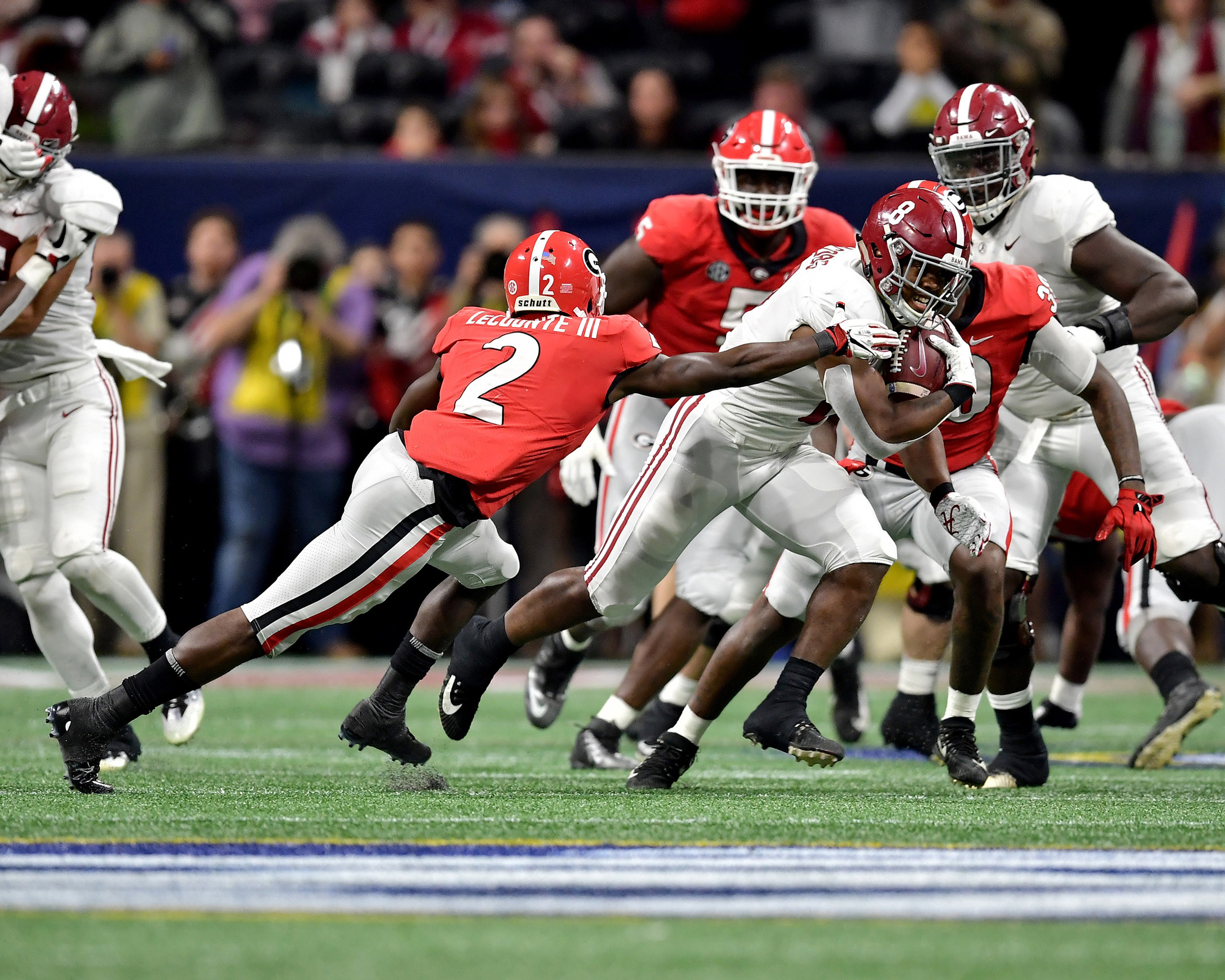 Alabama Crimson Tide running back Josh Jacobs (8) avoids a tackle during the first half of the 2018 SEC Championship football game against the Georgia Bulldogs at Mercedes-Benz Stadium in Atlanta, Ga., on Dec. 1, 2018. Alabama wins 35-28. (Photo by Lee Walls)