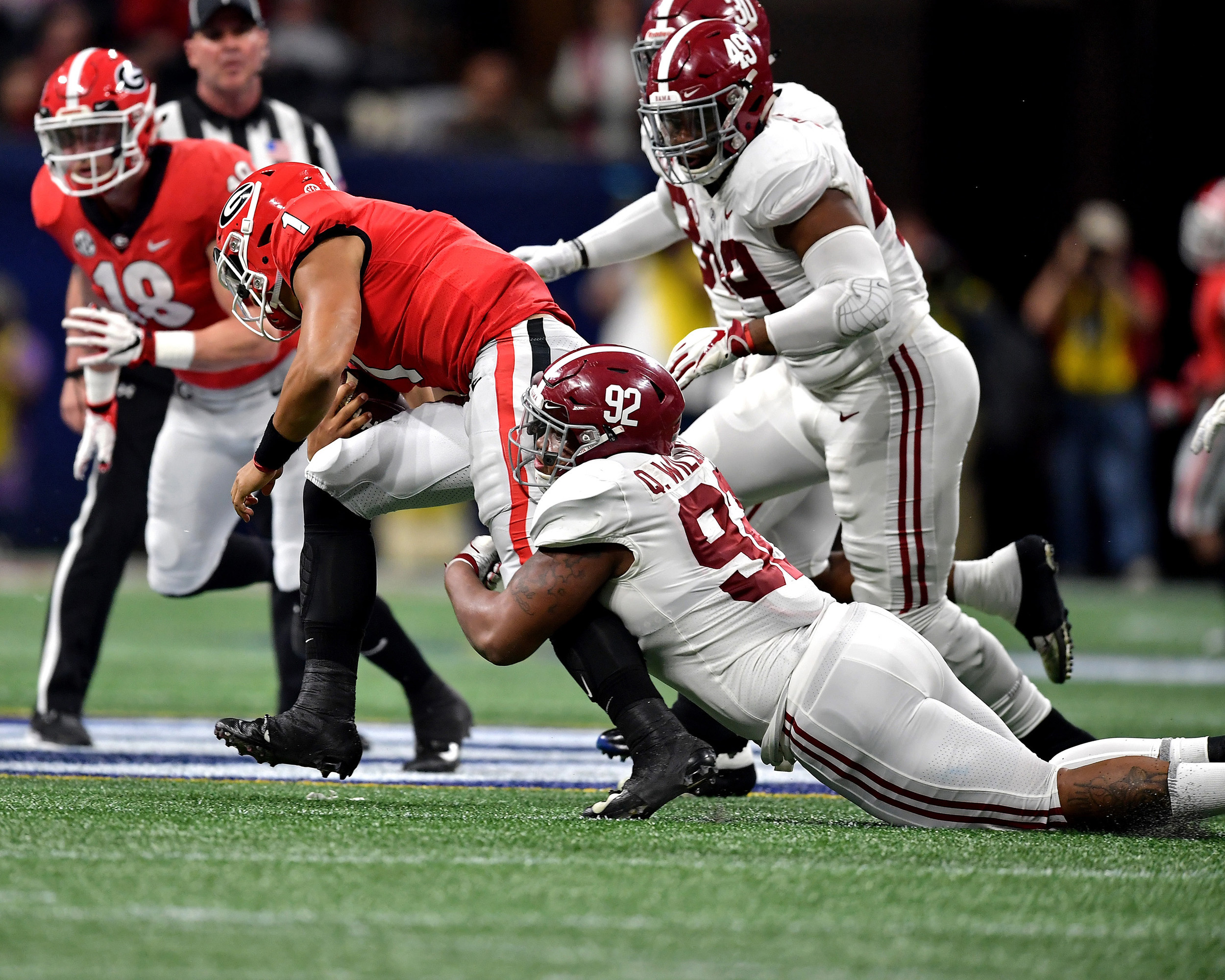 Alabama Crimson Tide defensive lineman Quinnen Williams (92) tackles Georgia Bulldogs quarterback Justin Fields (1) in the first half of the 2018 SEC Championship football game at Mercedes-Benz Stadium in Atlanta, Ga., on Dec. 1, 2018. Alabama wins 35-28. (Photo by Lee Walls)