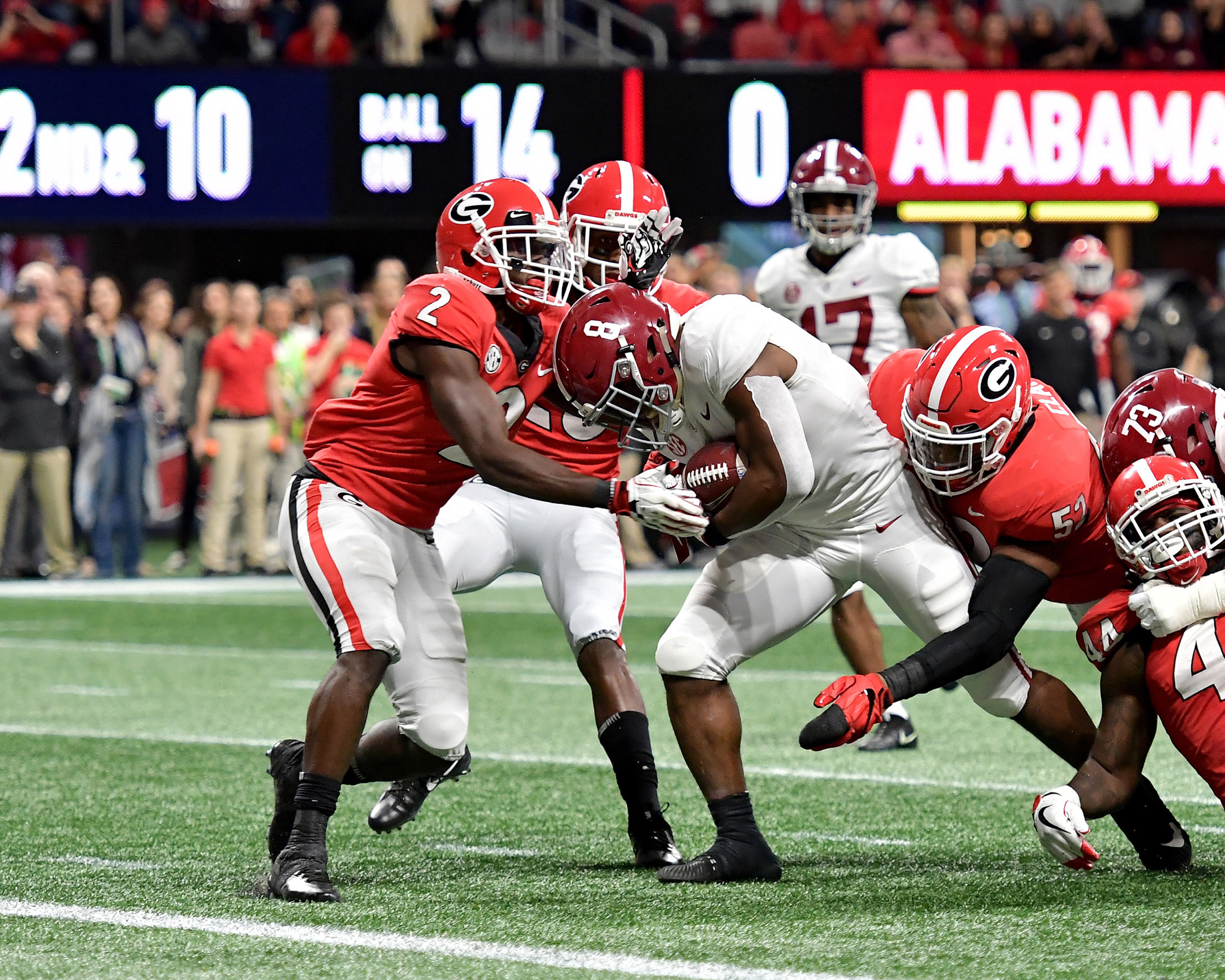 Alabama Crimson Tide running back Josh Jacobs (8), and eventual game MVP, on his way to a touchdown during the first half of the 2018 SEC Championship football game against the Georgia Bulldogs at Mercedes-Benz Stadium in Atlanta, Ga., on Dec. 1, 2018. Alabama wins 35-28. (Photo by Lee Walls)