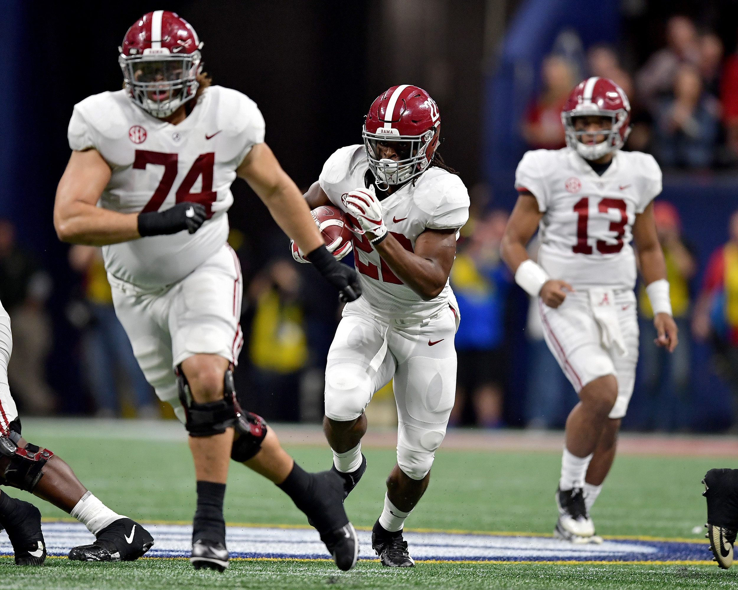 Alabama Crimson Tide running back Najee Harris (22) with a carry during the first half of the 2018 SEC Championship football game against the Georgia Bulldogs at Mercedes-Benz Stadium in Atlanta, Ga., on Dec. 1, 2018. Alabama wins 35-28. (Photo by Lee Walls)