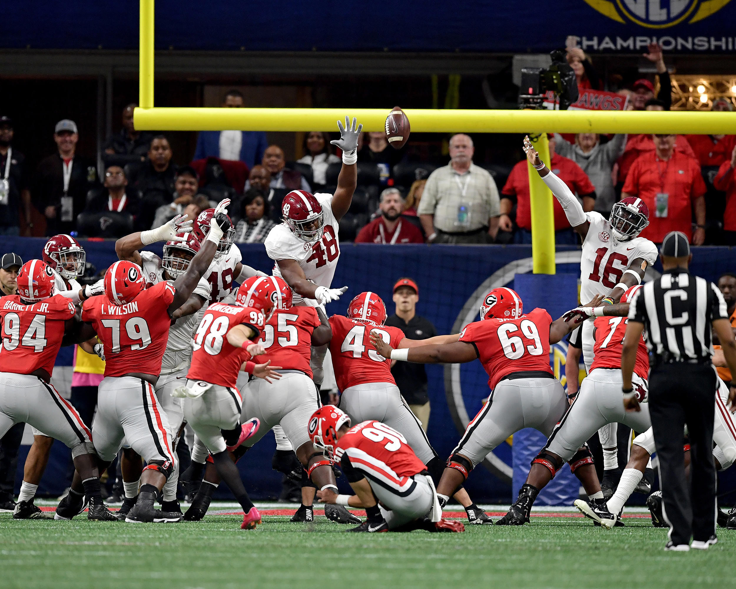 Georgia Bulldogs place kicker Rodrigo Blankenship (98) with the extra point during the first half of the 2018 SEC Championship football game, featuring the Bulldogs and the Alabama Crimson Tide, at Mercedes-Benz Stadium in Atlanta, Ga., on Dec. 1, 2018. Alabama wins 35-28. (Photo by Lee Walls)