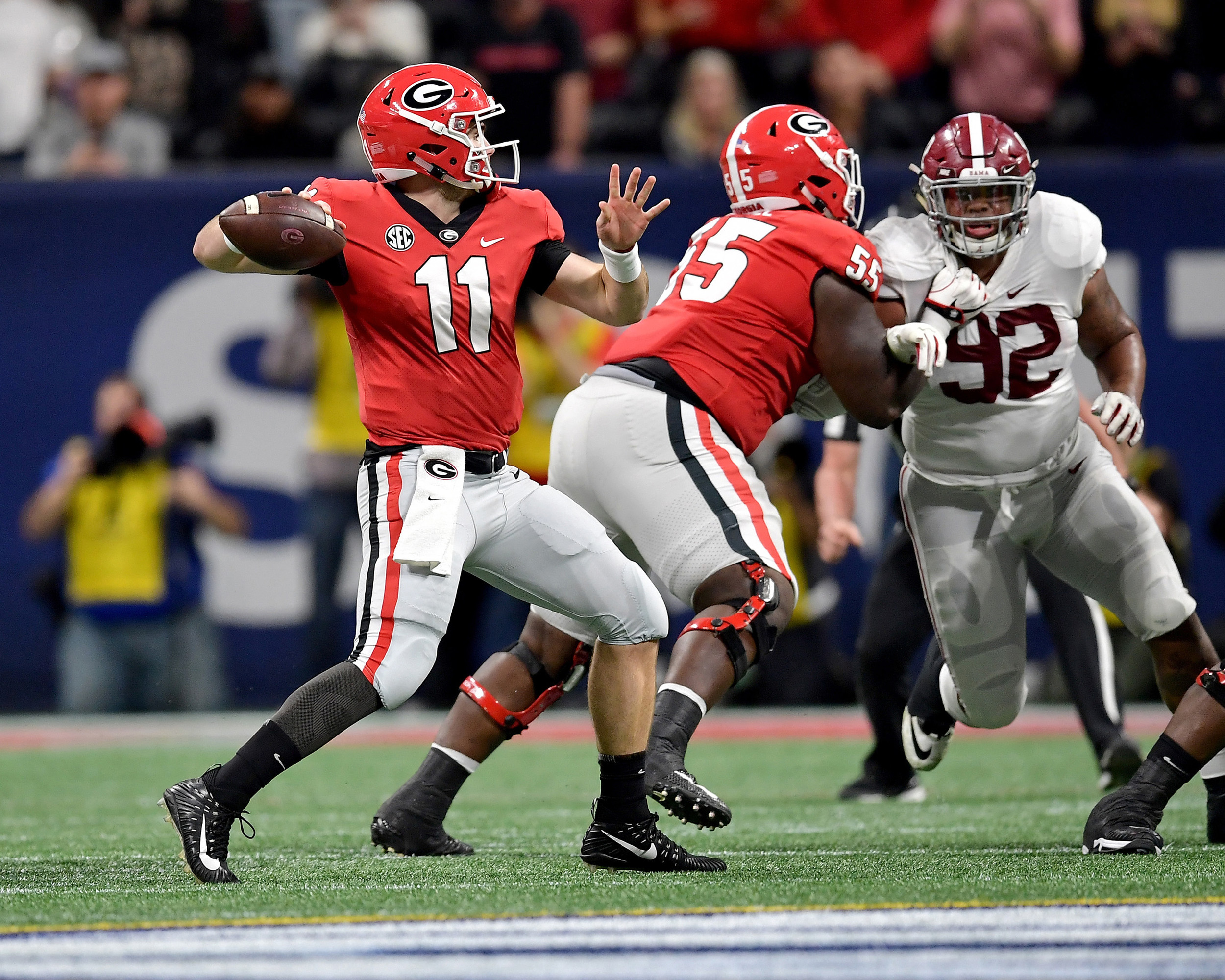 Georgia Bulldogs quarterback Jake Fromm (11) passes during the first half of the 2018 SEC Championship football game, featuring the Bulldogs and the Alabama Crimson Tide, at Mercedes-Benz Stadium in Atlanta, Ga., on Dec. 1, 2018. Alabama wins 35-28. (Photo by Lee Walls)