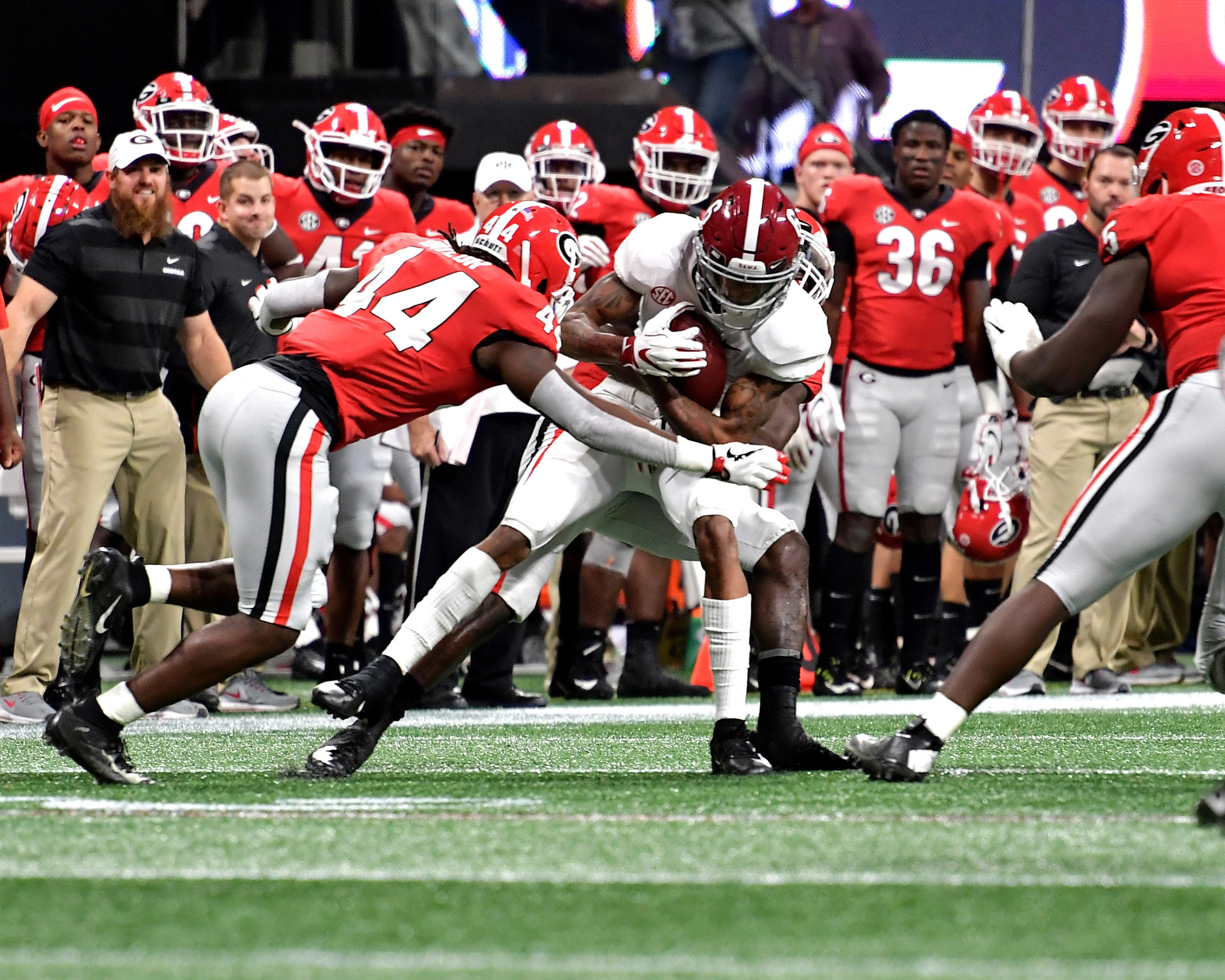 Alabama Crimson Tide wide receiver DeVonta Smith (6) is tackled during the first half of the 2018 SEC Championship football game at Mercedes-Benz Stadium in Atlanta, Ga., on Dec. 1, 2018. Alabama wins 35-28. (Photo by Lee Walls)