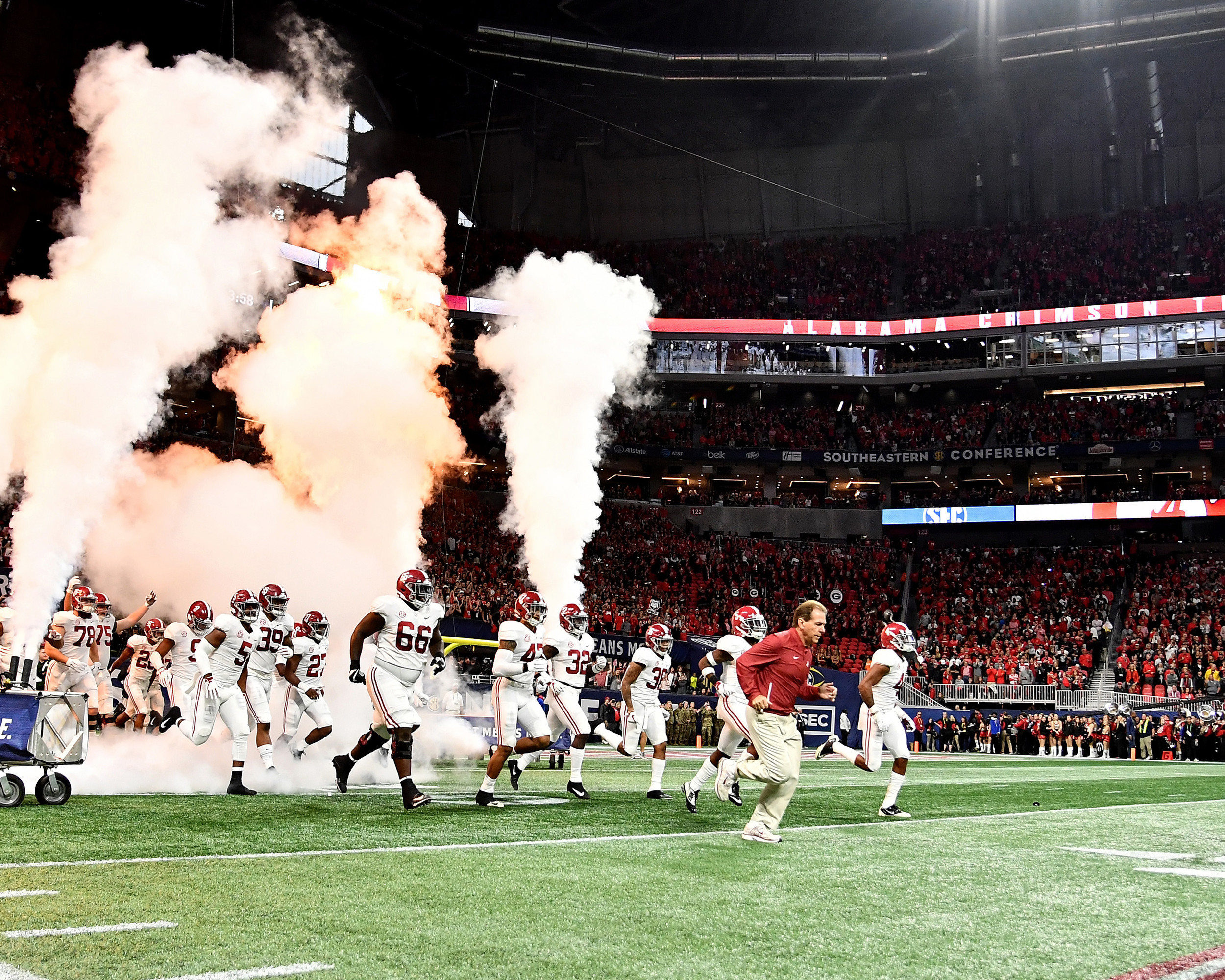 Alabama Crimson Tide head coach Nick Saban takes the field with his time prior to the 2018 SEC Championship football game, featuring the Georgia Bulldogs and the Alabama Crimson Tide, at Mercedes-Benz Stadium in Atlanta, Ga., on Dec. 1, 2018. Alabama wins 35-28. (Photo by Lee Walls)