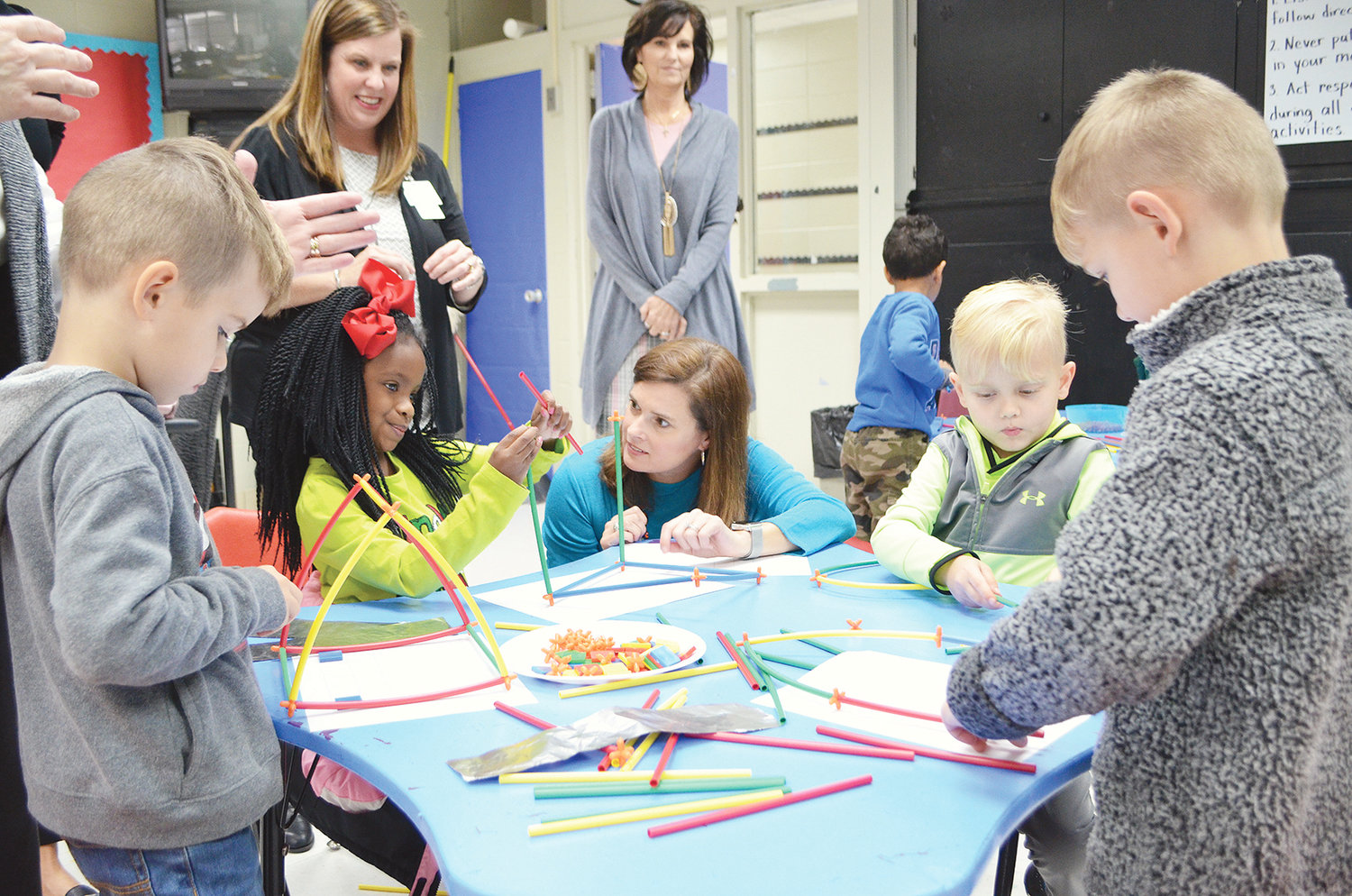 Jasper City Board of Education member Mary Beth Barber, center, observes students at T.R. Simmons Elementary School participating in a STEM activity Wednesday.