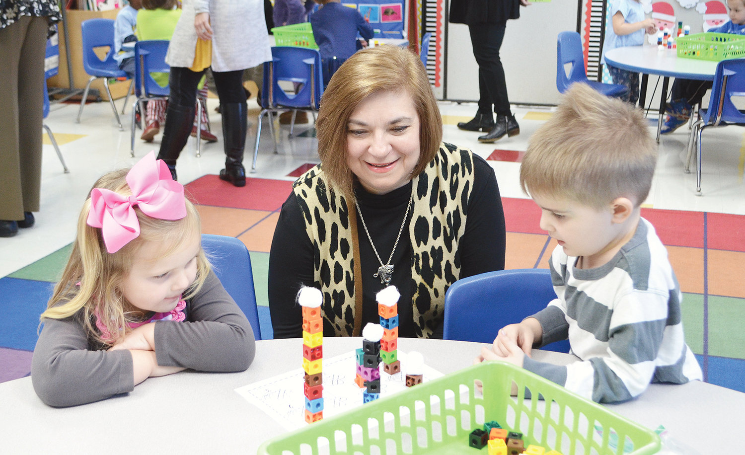 Jasper City Schools board member Teresa Sherer visits with some students at T.R. Simmons Elementary Wednesday.