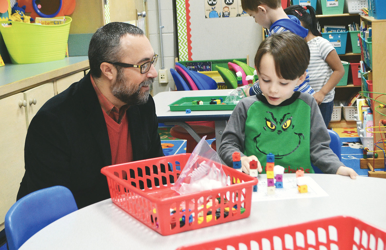 Jasper City Schools board member Walker Wilson works with a T.R. Simmons Elementary student Wednesday.