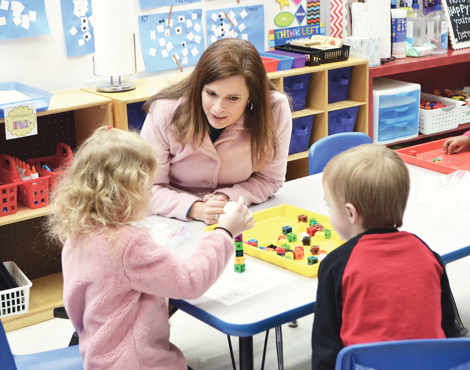 Jasper City Board of Education member Mary Beth Barber works with a student at T.R. Simmons Elementary Wednesday.