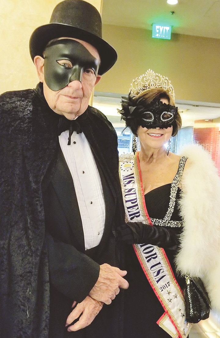 "Ms. Super Senior Universe Sally Beth Vick and her husband, Jimmy, wore costumes inspired by ""Phantom of the Opera"" to the Queens' Masquerade Ball that was held at the home of Cindy Doumani, former owner of the Tropicana Resort and Casino."