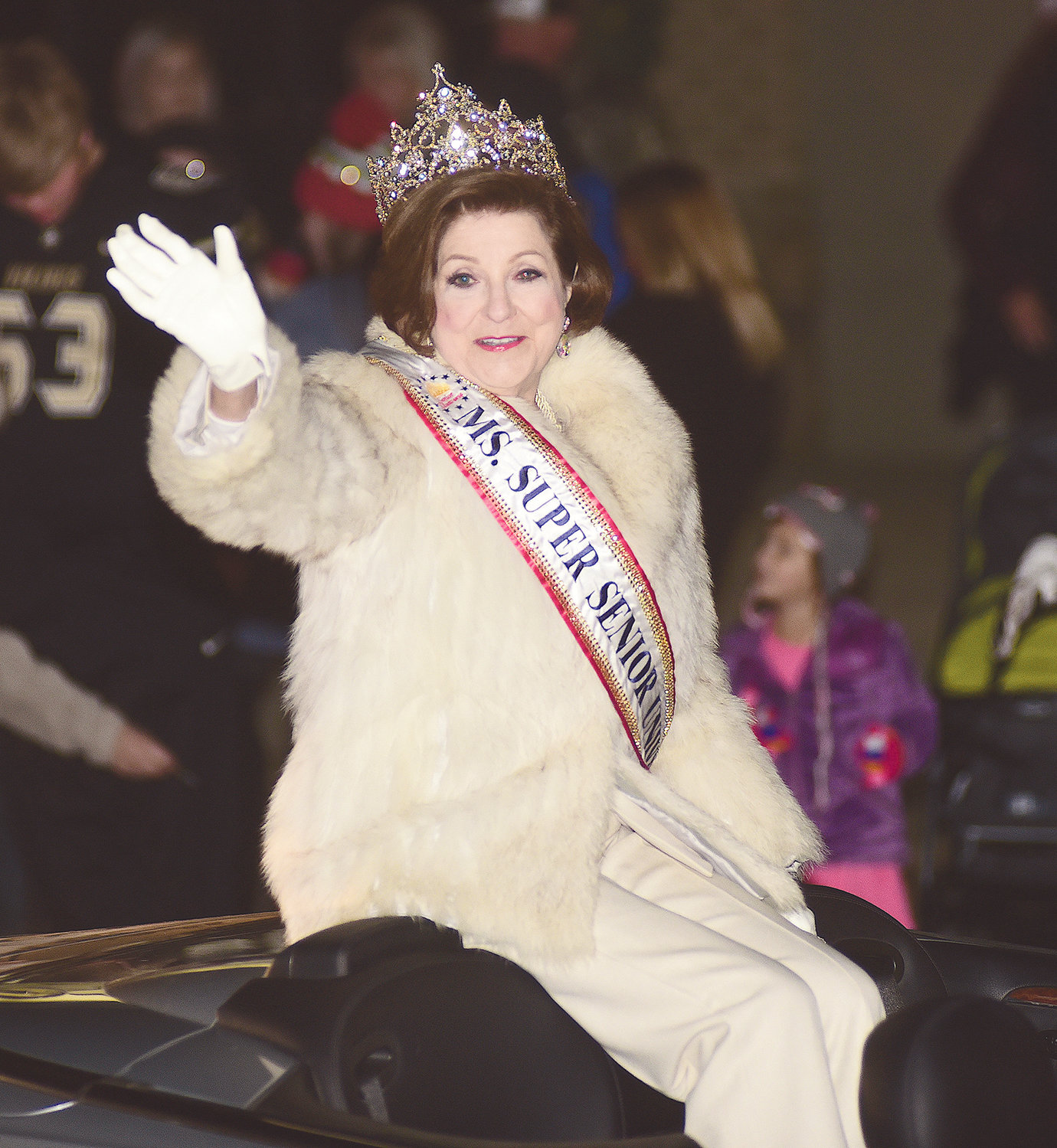 Sally Beth Vick of Jasper, the newly crowned 2019 Ms. Super Senior Universe, waves to the crowd at Tuesday's Chamber of Commerce of Walker County Christmas parade in Jasper.
