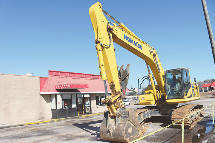 Demolition rolled in to tear down the old Jack's building in Dora to make room for the new building.