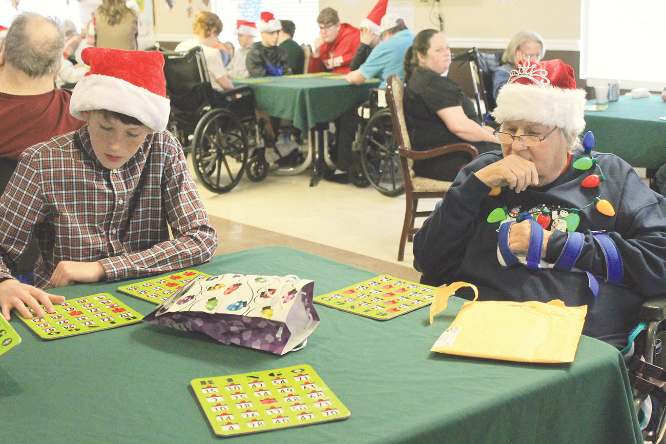 Bankhead Middle School students involved in a community service club play bingo with residents at Cordova Health and Rehabilitation on Wednesday. The monthly Club Day activities are meant to expose students to experiences not part of an average school day and will become part of the school's documentation for STEM certification.