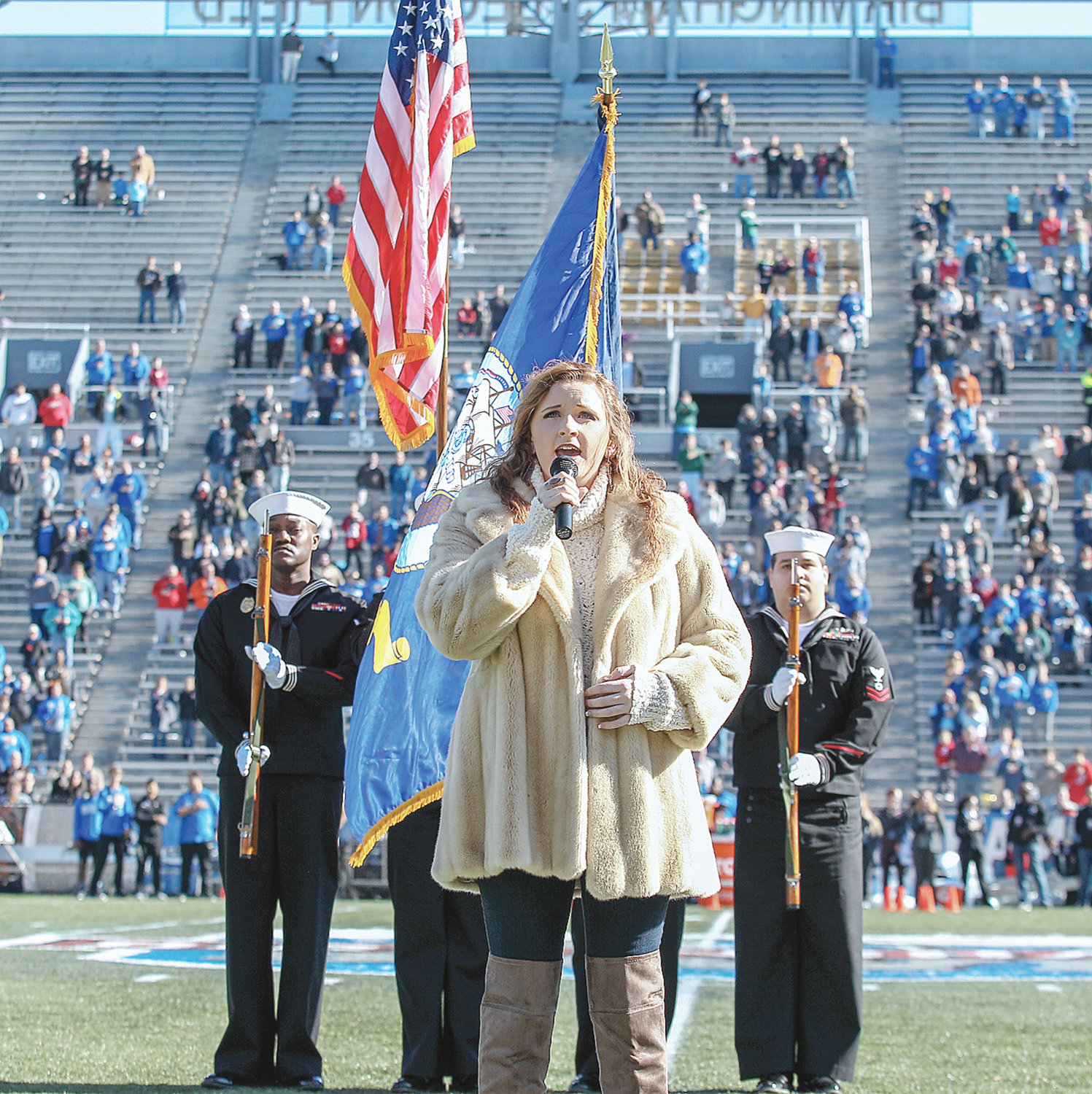 Cordova High School senior Allie Sickles performs the national anthem prior to the 2018 Jared Birmingham Bowl on Dec. 22, 2018, at Legion Field in Birmingham.