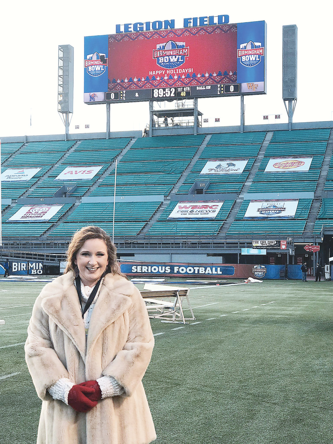 Allie Sickles takes a moment for a photo op at Legion Field prior to performing the national anthem at the Birmingham Bowl.