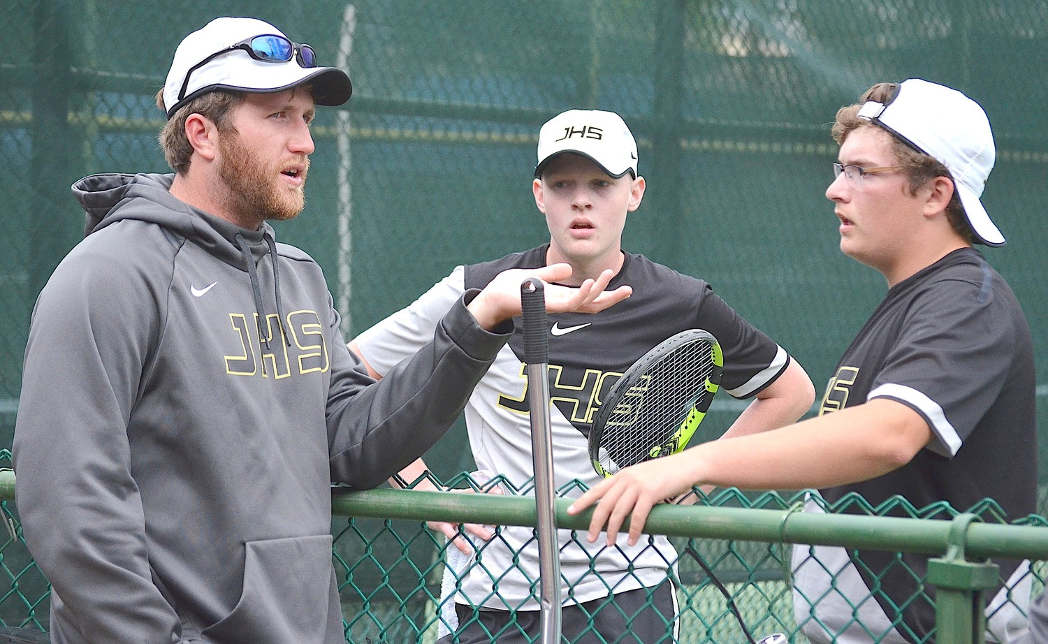Jasper tennis coach Christian Matthews talks to players during the State Tennis Tournament in Montgomery. The Jasper boys won the Class 6A state title.