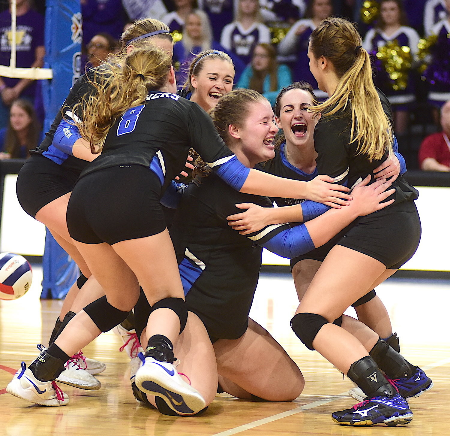 Addison volleyball players celebrate their state championship win over Winston County in Birmingham.